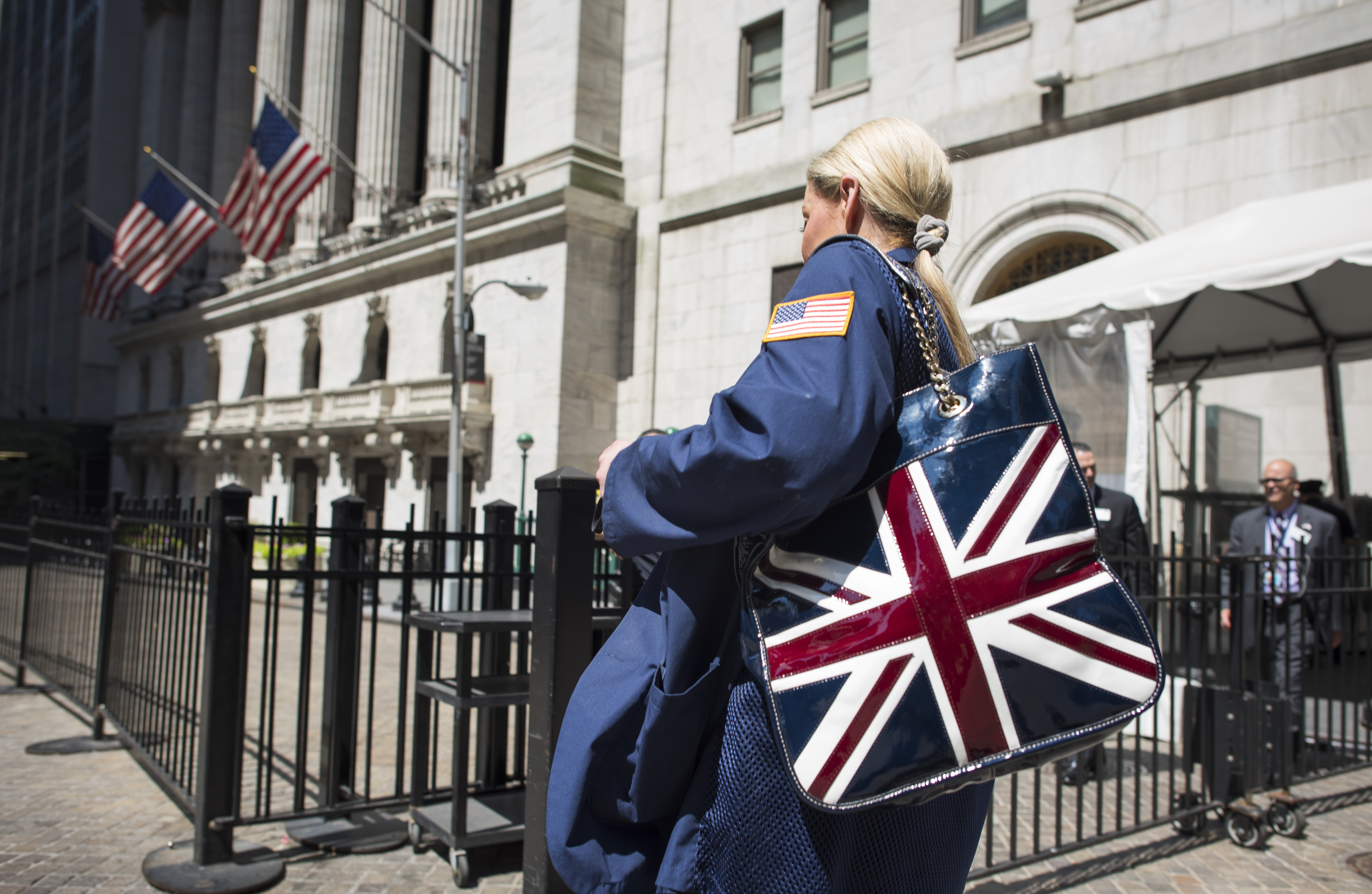A trader with Union Jack bag enters the New York Stock Exchange a day after Britain voted to break out of the European Union. It could be worrisome if Brexit marks an end to the economic integration and open markets that have helped power sales at companies.