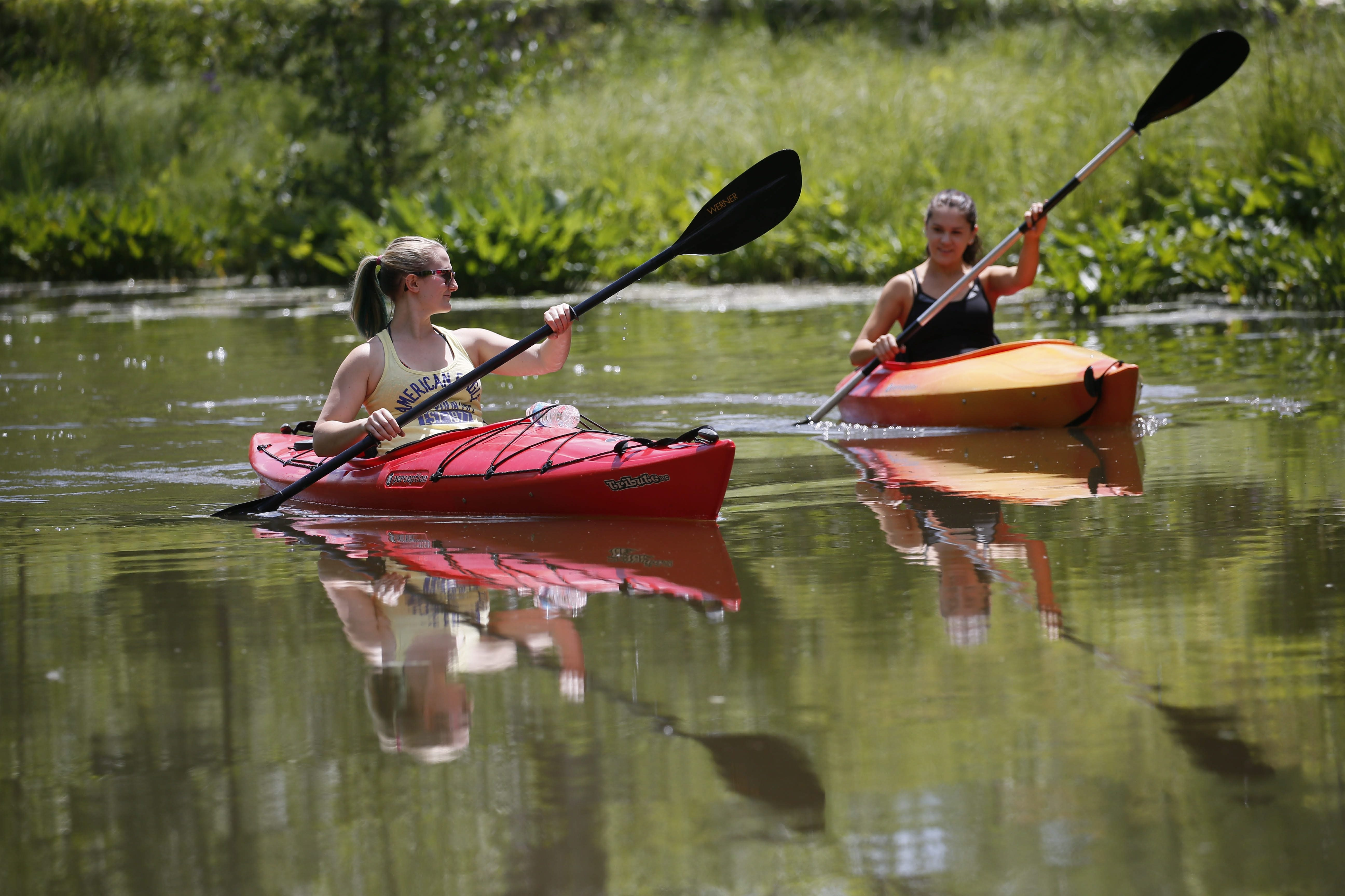 Steph Aronica, left, and Jackie Nusstein of Grand Island paddle kayaks down Woods Creek in Buckhorn Island State Park, last summer. (Derek Gee/Buffalo News)