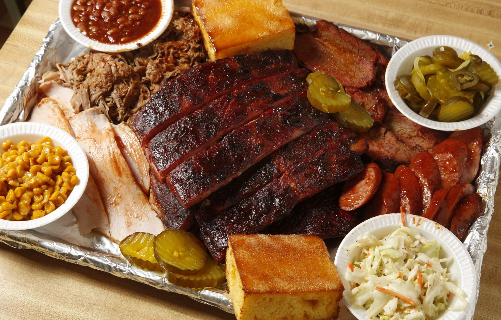 Included in this platter is a rack of ribs and half heaps of turkey, pork, brisket and sausage. Sides are fried corn, baked beans, fire and ice pickles, creamy coleslaw and toasted cornbread.