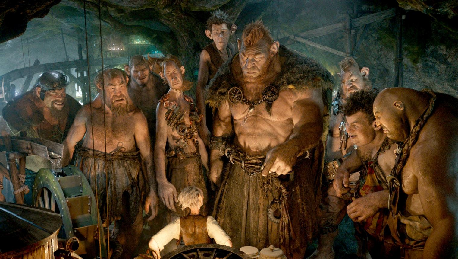 """Gizzardgulper, Childchewer, Maidmasher, Bloodbottler, Manhugger, Fleshlumpeater, Meatdripper, Butcherboy and Bonecruncher surround the giant in """"The BFG."""""""