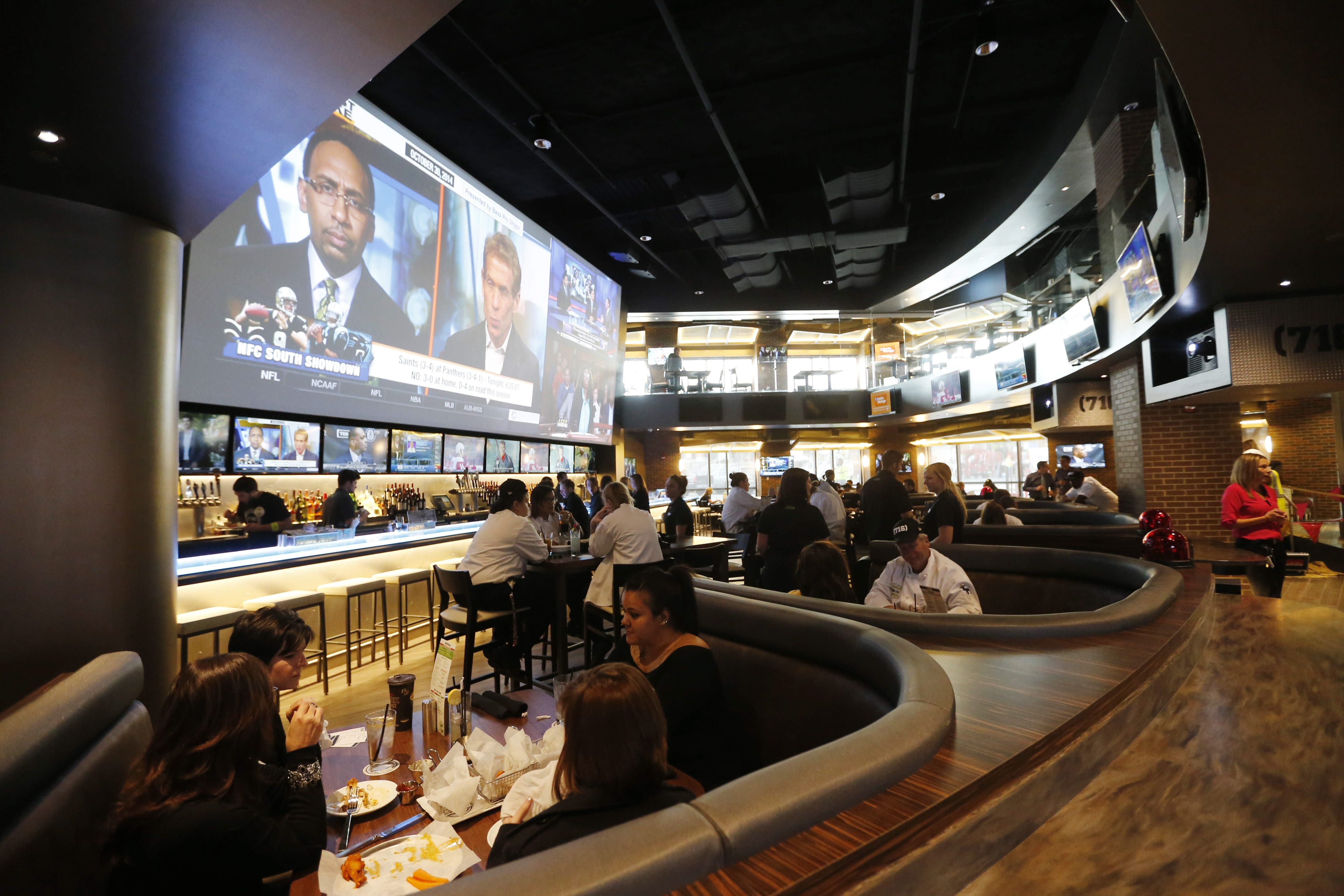 One expansive television (and dozens of others) are a big draw at  (716) Food & Sport at HarborCenter. (Derek Gee/Buffalo News)