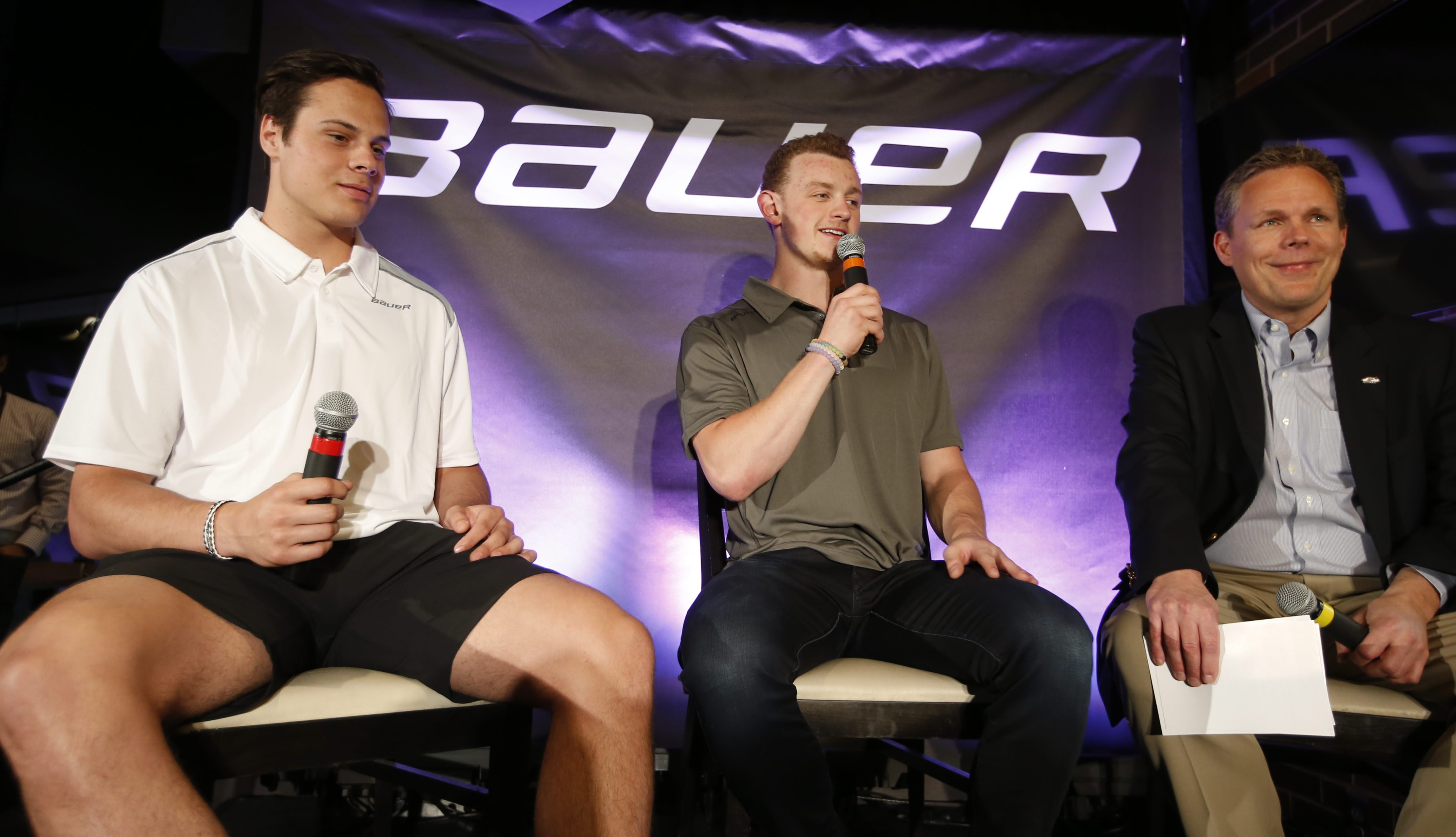 NHL prospect Auston Matthews and Buffalo Sabres Jack EIchel are interviewed during Bauer hockey equipment event on Thursday. (Harry Scull Jr./Buffalo News)