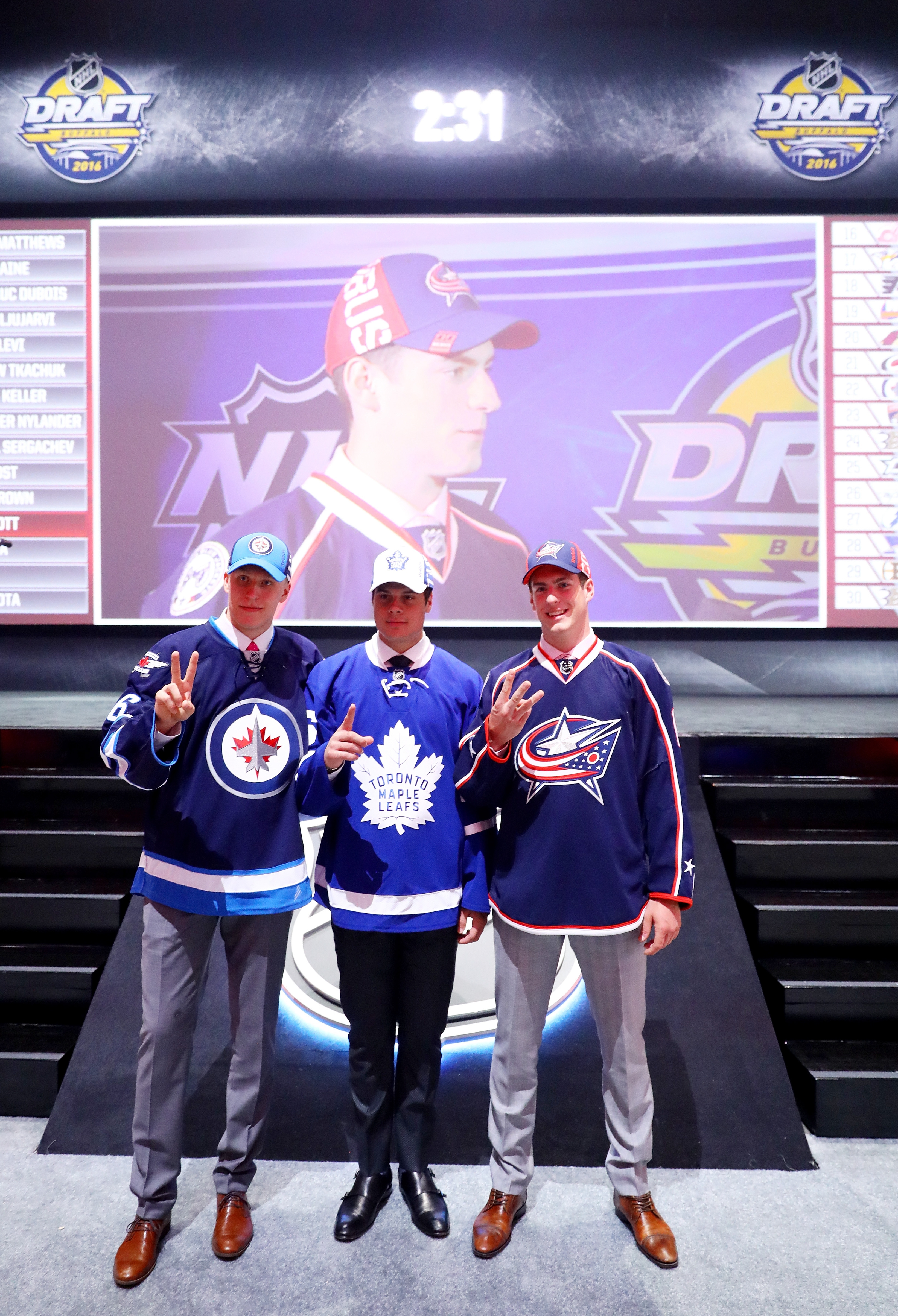 Winnipeg's Patrik Laine, Toronto's Auston Matthews and Columbus' Pierre-Luc Dubois pose together after being the first three selections in the first round of the NHL Draft on Friday at First Niagara Center.