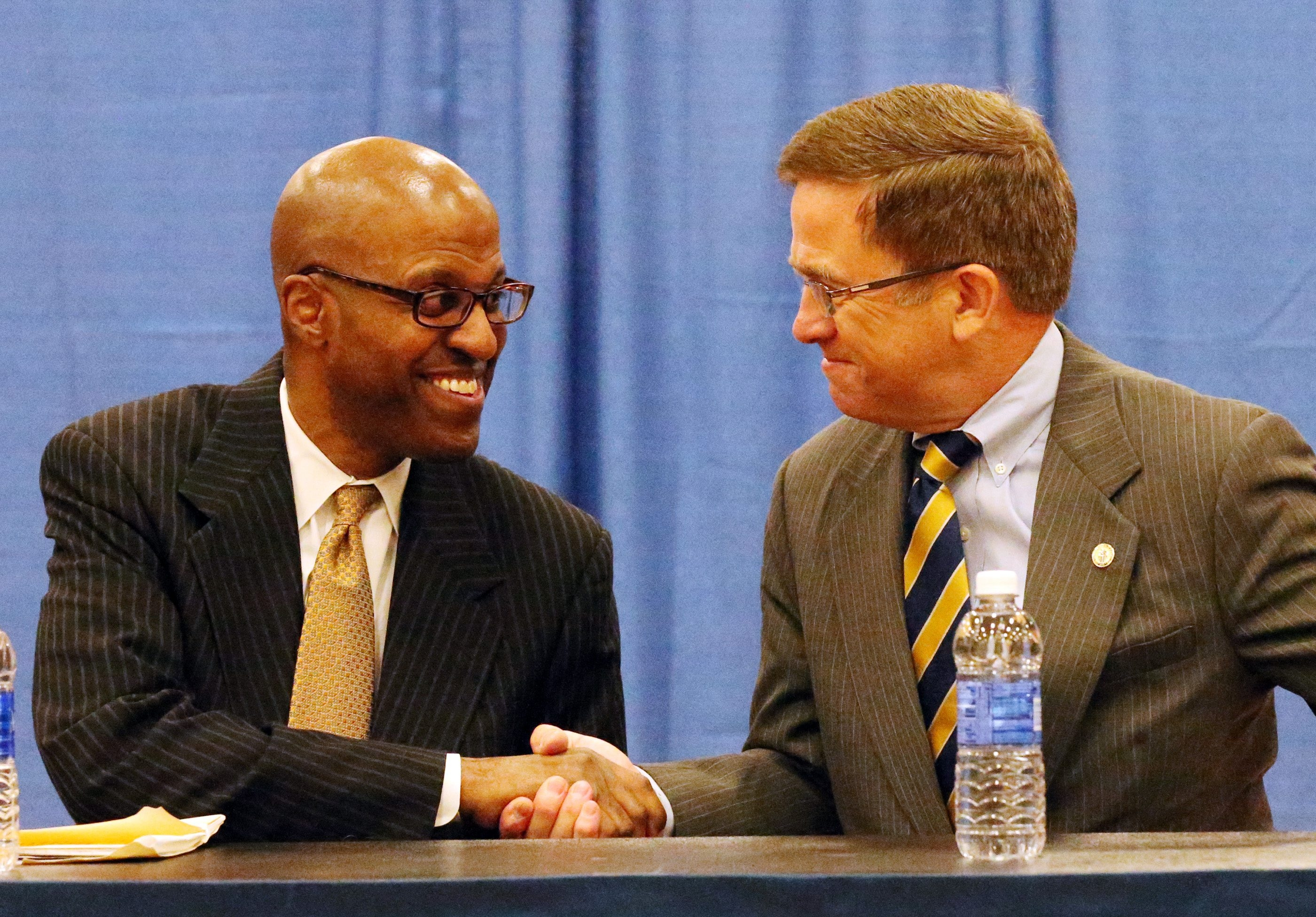 Canisius College President John J. Hurley introduces Reggie Witherspoon as the new head basketball coach during Tuesday's news conference.