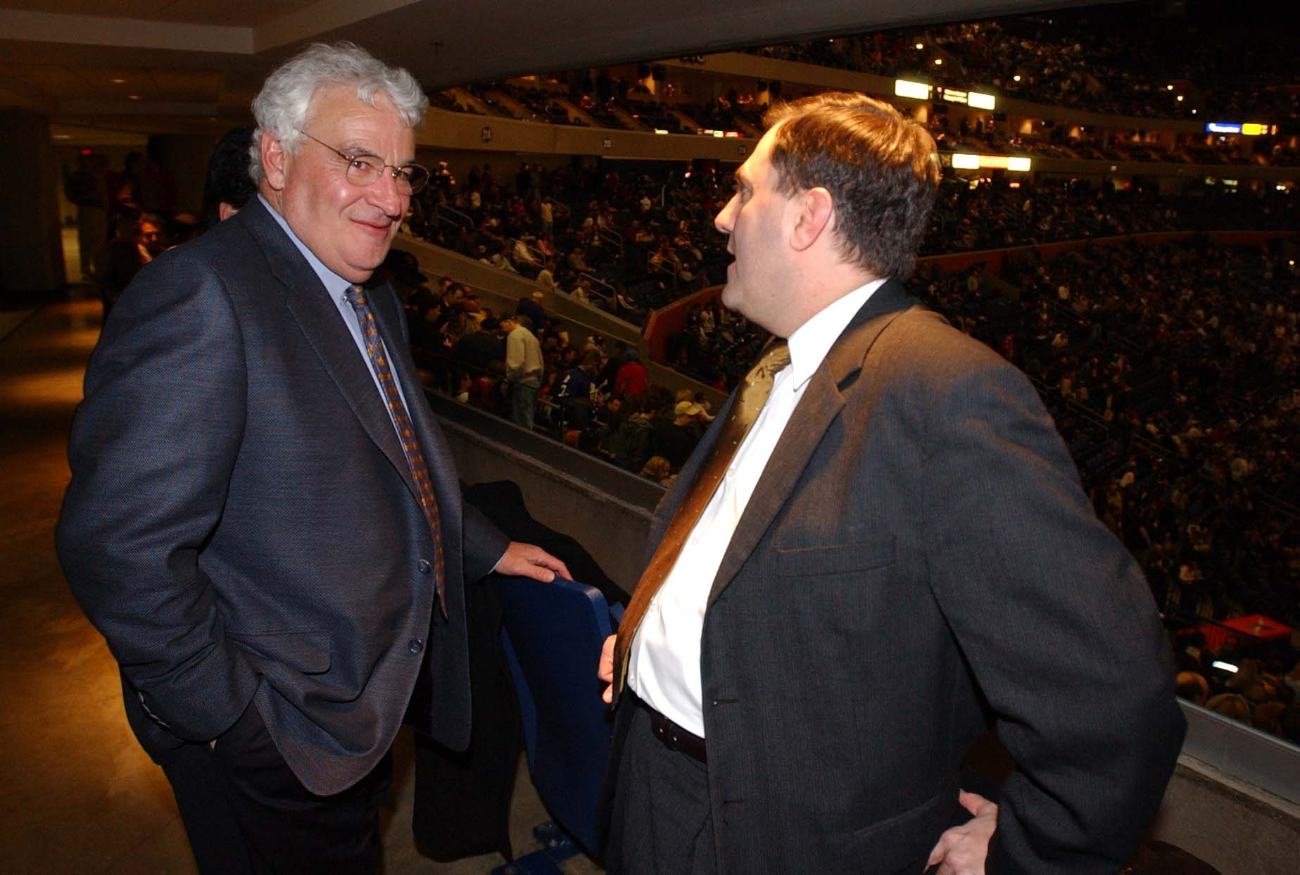 LOCAL GOLISANO --- Tom Golisano , left, talks with Steve Pigeon at the HSBC Arena in between periods where the Buffalo Sabres were playing the Toronto Maple Leafs on 1/24/03 in Buffalo, N.Y. Photo by John Hickey