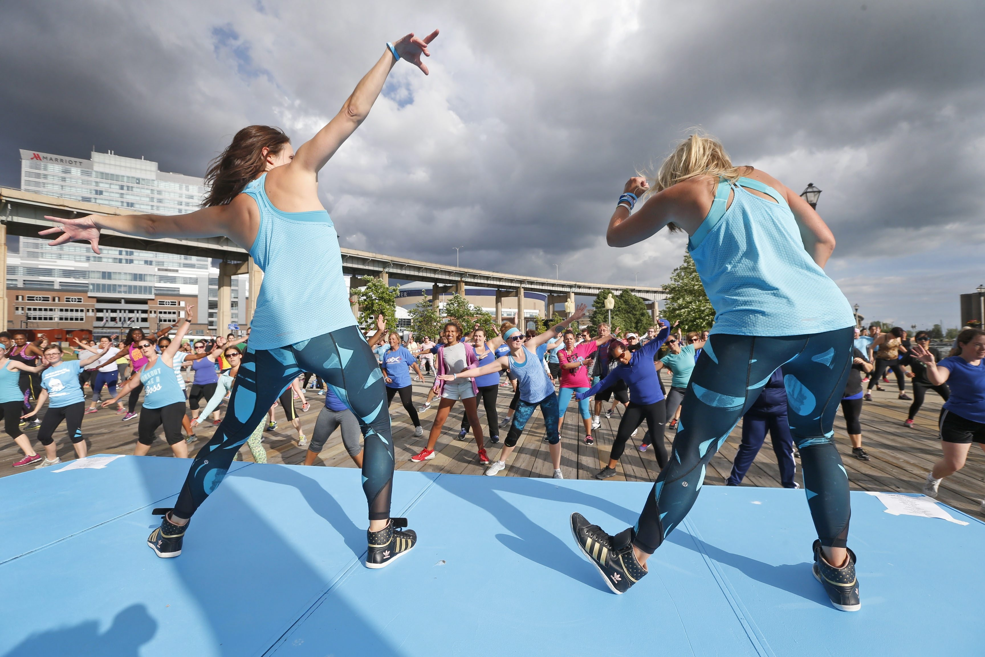 Zumba instructors Meghan Schimmelpenninck, left, and Jen Wright lead participants at Canalside.  (Robert Kirkham/Buffalo News)