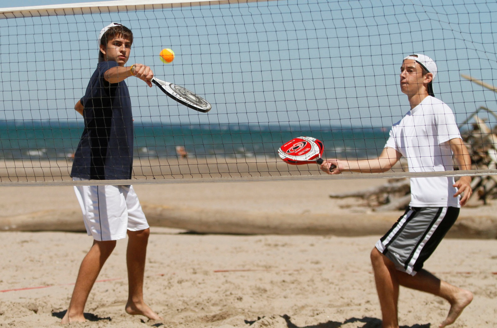 Zach Gabryel, left, hits a ball as Dominic Eusanio looks on in beach tennis at Woodlawn Beach State Park in 2010. (John Hickey/Buffalo News file photo)