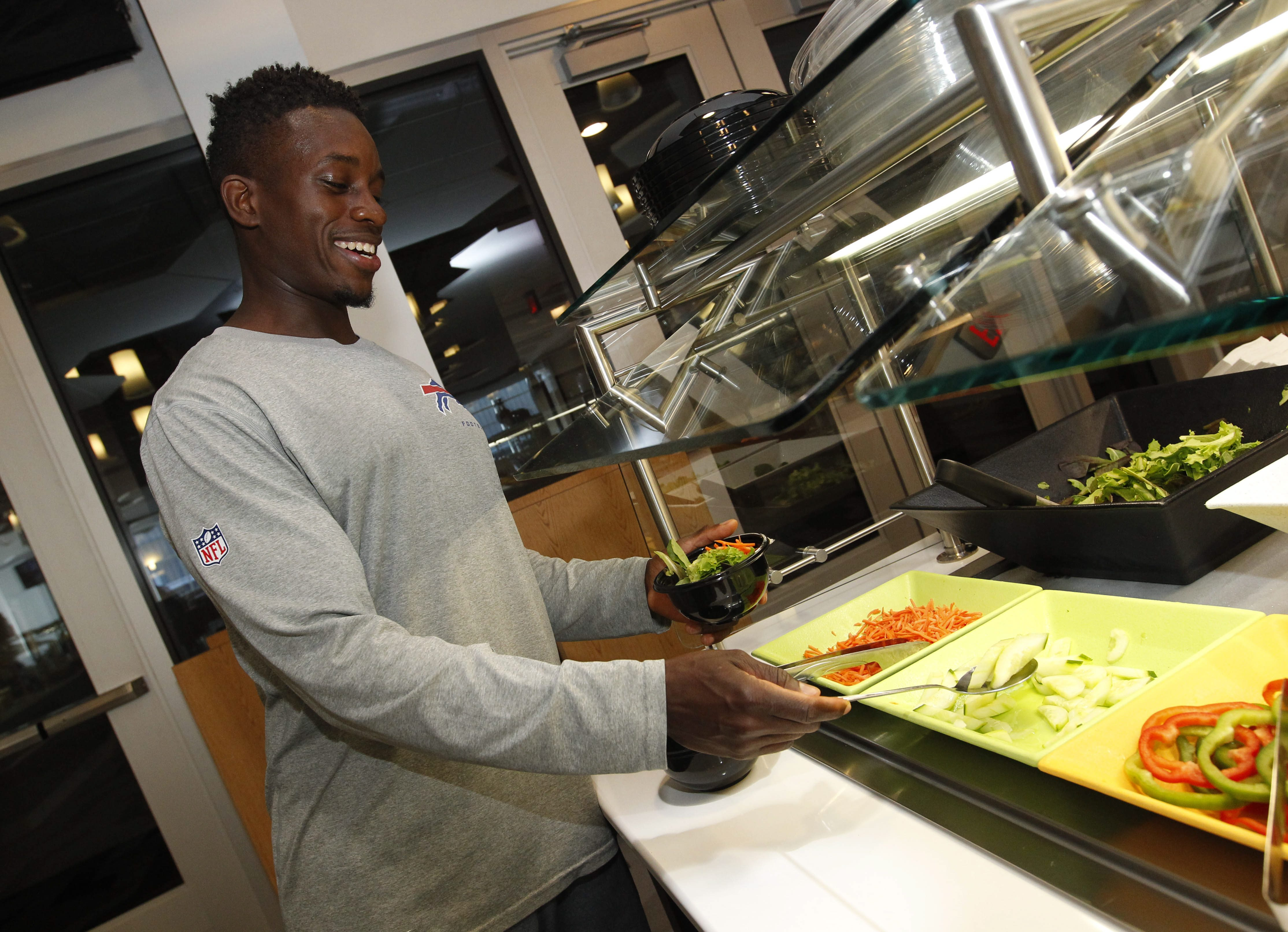 "Bills assistant fitness trainer and nutrition specialist Dan LiBurd, shown here getting himself a salad after practice in 2014, will appear on the June 27 episode of ""American Ninja Warrior"" TV show. (Sharon Cantillon/News file photo)"