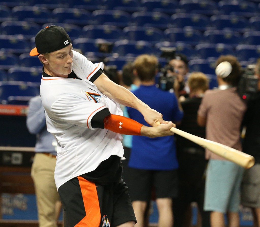 Wearing a Miami Marlins jersey, Jack Eichel takes his cuts in Marlins Park last June prior to the NHL Draft (James P. McCoy/Buffalo News).