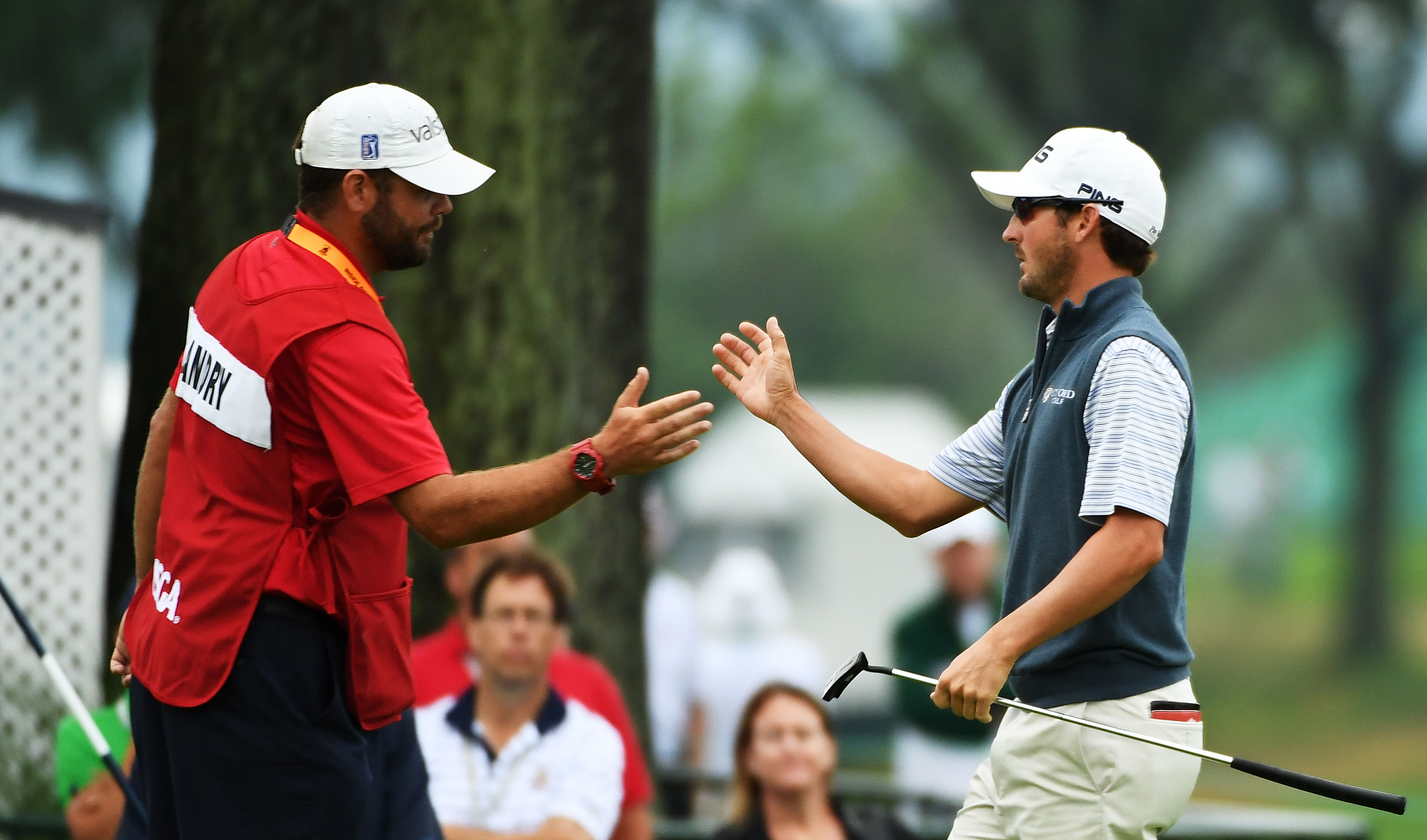 Andrew Landry extends a hand to his caddie, Kevin Ensor, after finishing the first round of the U.S. Open  on Friday. (Getty Images)