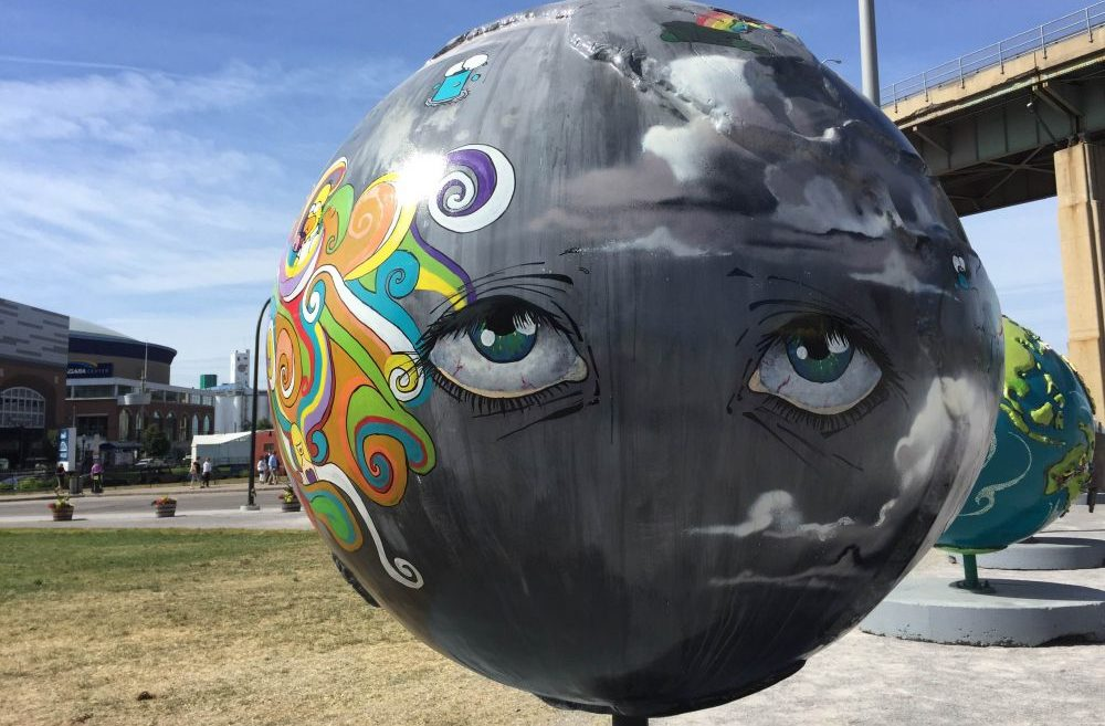 "The ""Cool Globes"" public art exhibit features a dozen designed spheres aimed at raising awareness about solutions to climate change. (Aaron Besecker/Buffalo News)"