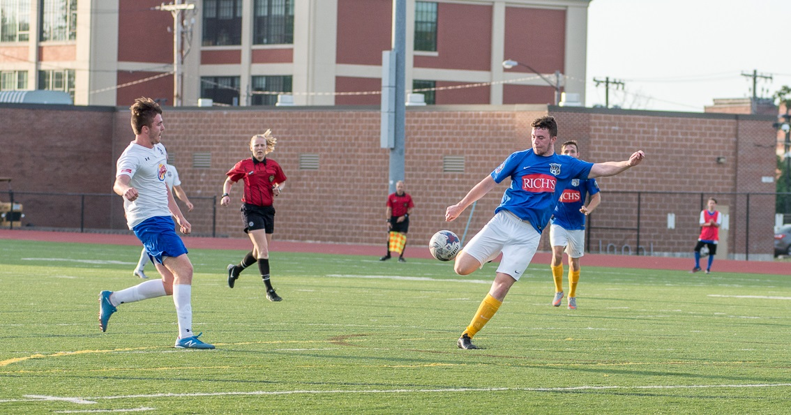 FC Buffalo's Kieran Toland, about to strike a volley, has been one of the club's better midfielders. (Matt Weinberg/Special to The News)