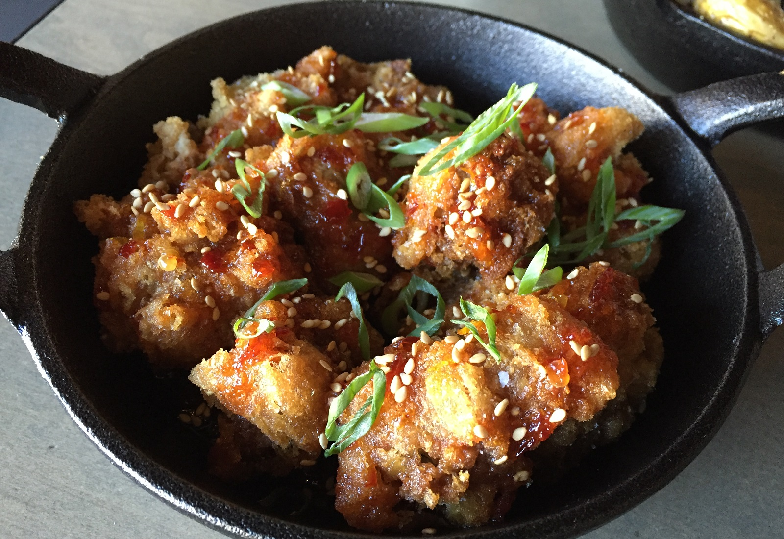 Delicately fried chicken livers in an orange-sambal sauce evoked memories of Chinese takeout. (Caitlin Hartney/Special to The News)