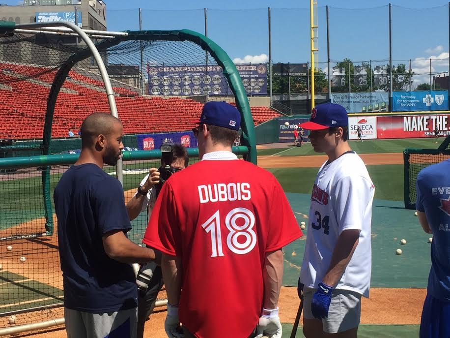 Bisons outfielder Dalton Pompey (left) talks to NHL draft prospects Pierre-Luc Dubois and Auston Matthews Wednesday in Coca-Cola Field (Mike Harrington/Buffalo News).
