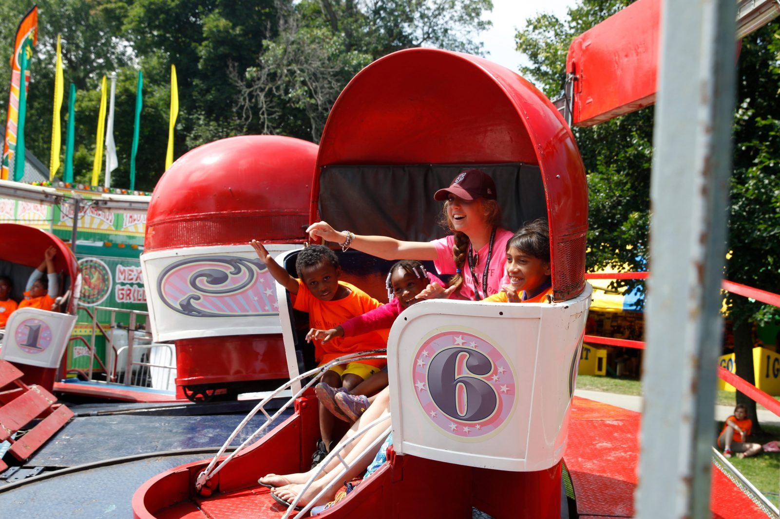 Markawan and Amanda with Camp Counselor Jessie Teiboeo and Genesis ride Tilt a Whirl at the Old Home Days Celebration in Island Park, in Williamsville, N.Y., on Wednesday, July 8, 2015.The group was from St. Luke Mission and part of a group called Kids from the Kingdom. (John Hickey/Buffalo News)