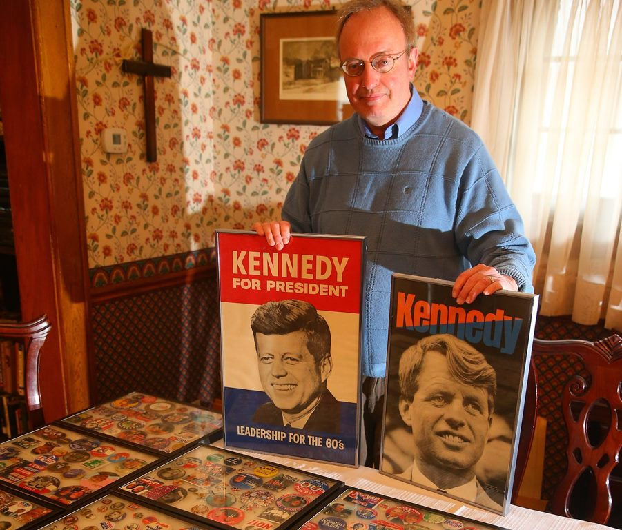 A 1960 poster of JFK and a 1968 poster of RFK are Bob Dearing's favorite items in his collection of campaign memorabilia. (John Hickey/Buffalo News)