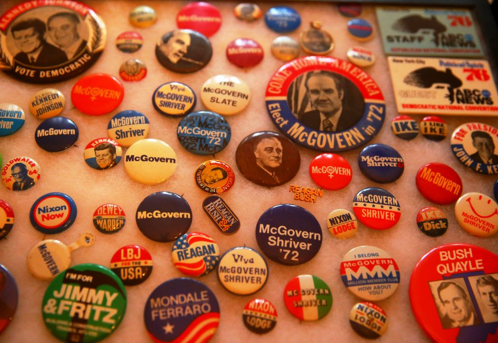 Political buttons in Bob Dearing's collection include several of George McGovern's 1972 presidential run. (John Hickey/Buffalo News)