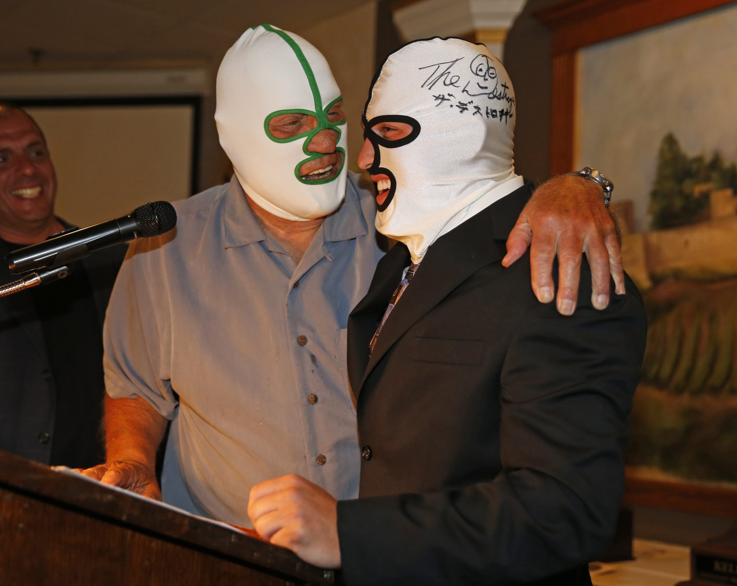 Dick 'The Destroyer' Beyer, left, honors Fredonia's Dakota Gardner during last spring's Ilio DiPaolo Scholarship Awards Banquet. Beyer will be among the wrestling legends on hand Friday and Saturday for the Wrestling Legends of the Aud 20th Anniversary Night.  (Harry Scull Jr./Buffalo News)