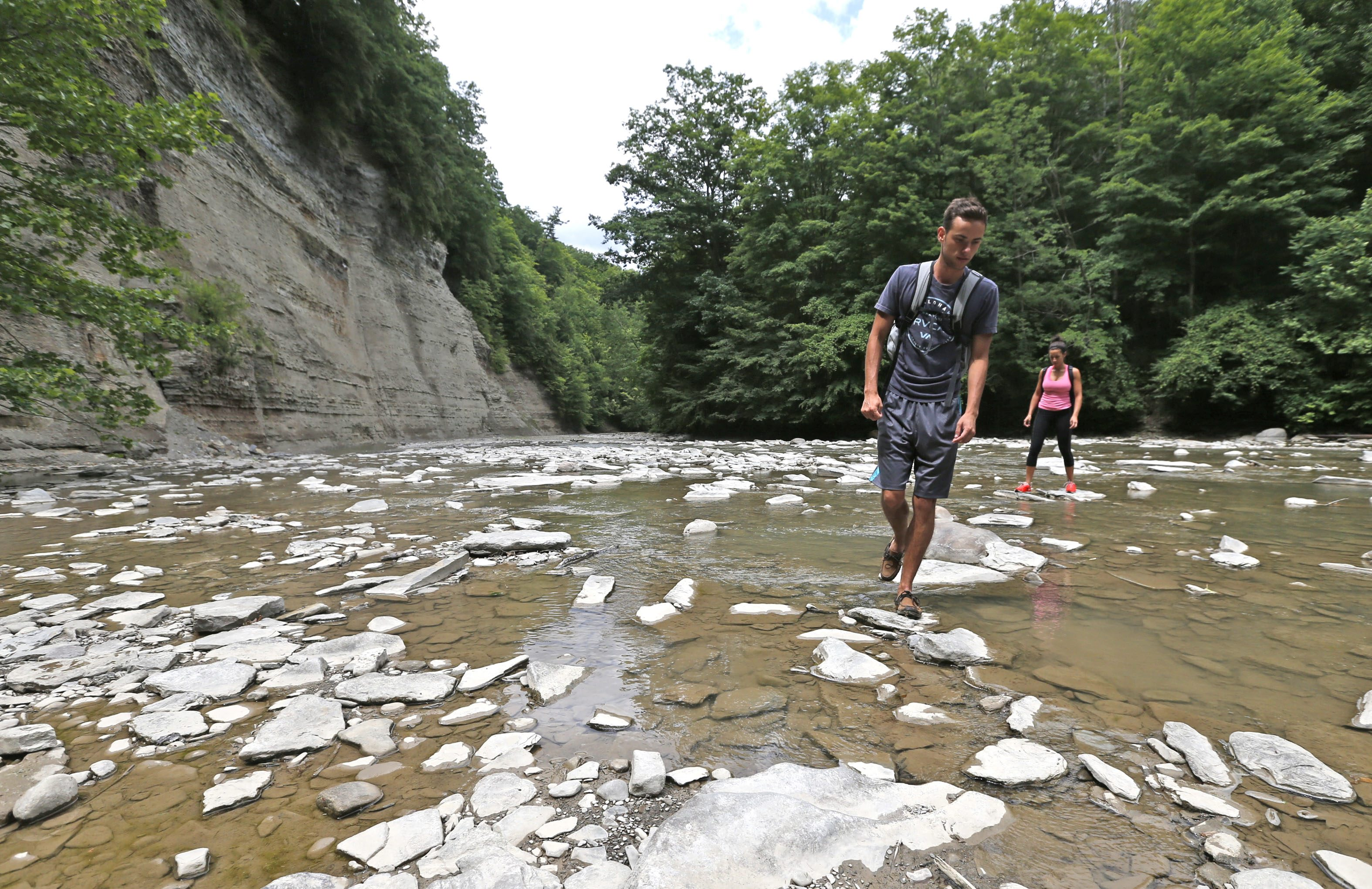 Hiking companions Zachary Szafranek of Buffalo and Jessica Pieters of Amherst explore the Cattaraugus Creek gorge at Zoar Valley.  (Robert Kirkham/Buffalo News)