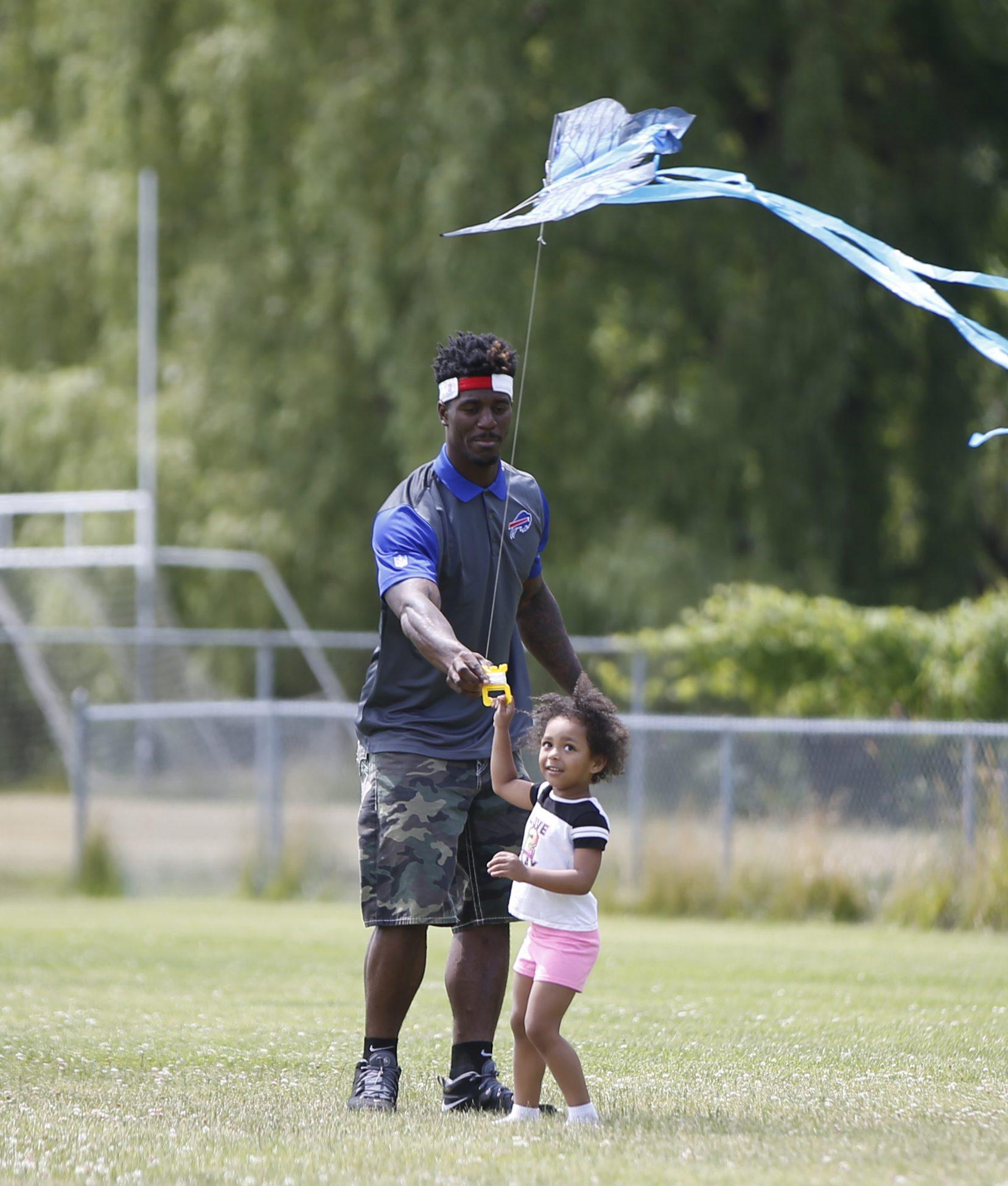 James Wilder flies a kite with his daughter, Nala. (Harry Scull Jr./Buffalo News)