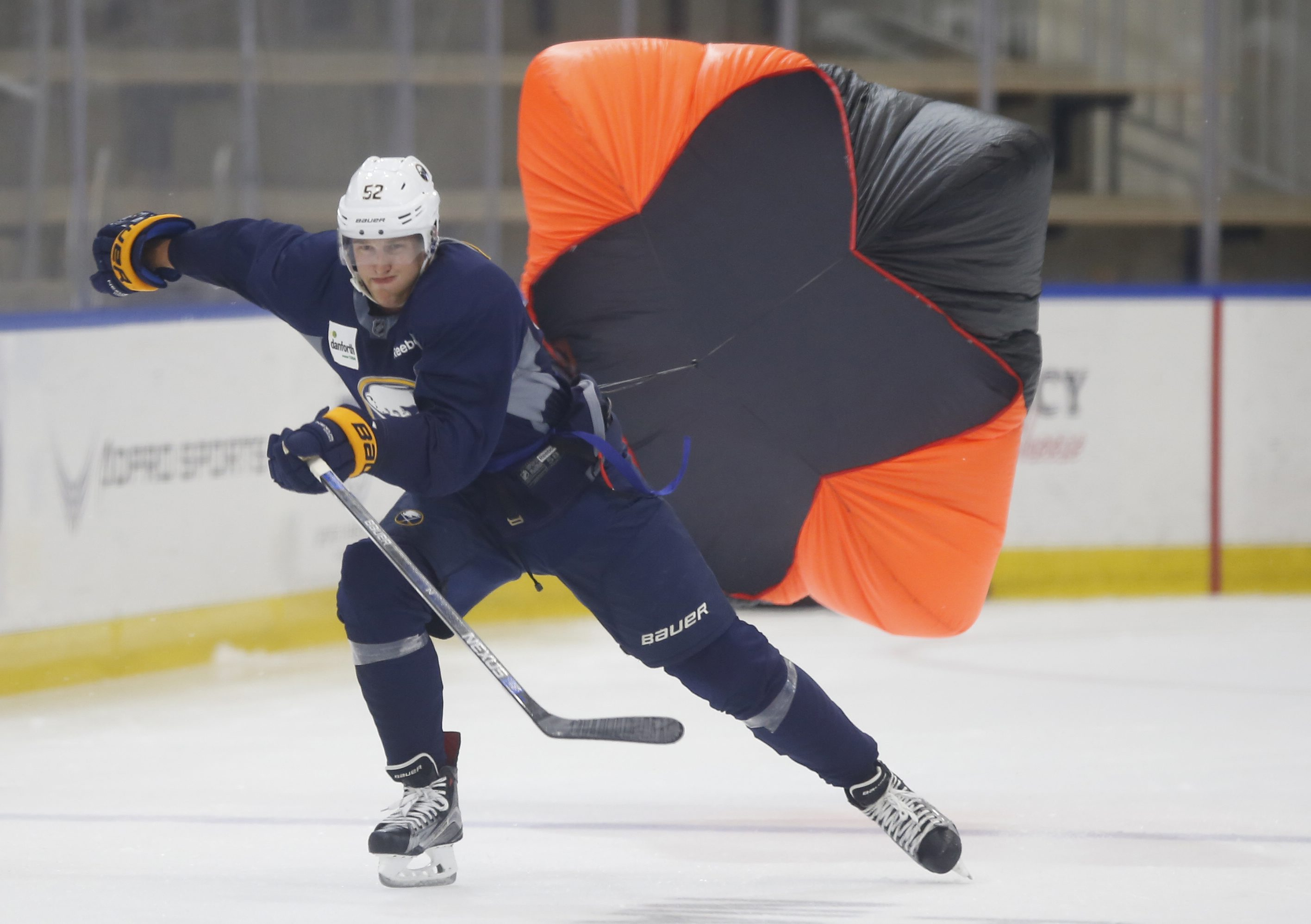 Sabres prospect Hudson Fasching participates in a parachute drill during development camp Thursday in HarborCenter. (Harry Scull Jr./Buffalo News)
