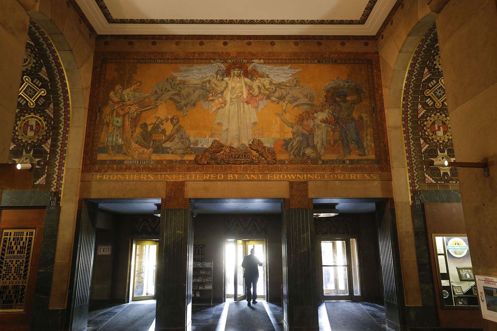The mural 'Frontiers Unfettered by any Frowning Fortress' by artist William de Leftwich-Dodge over the main entrance in the grand lobby of Buffalo City Hall, Monday, June 20, 2016.  (Photo by Derek Gee)