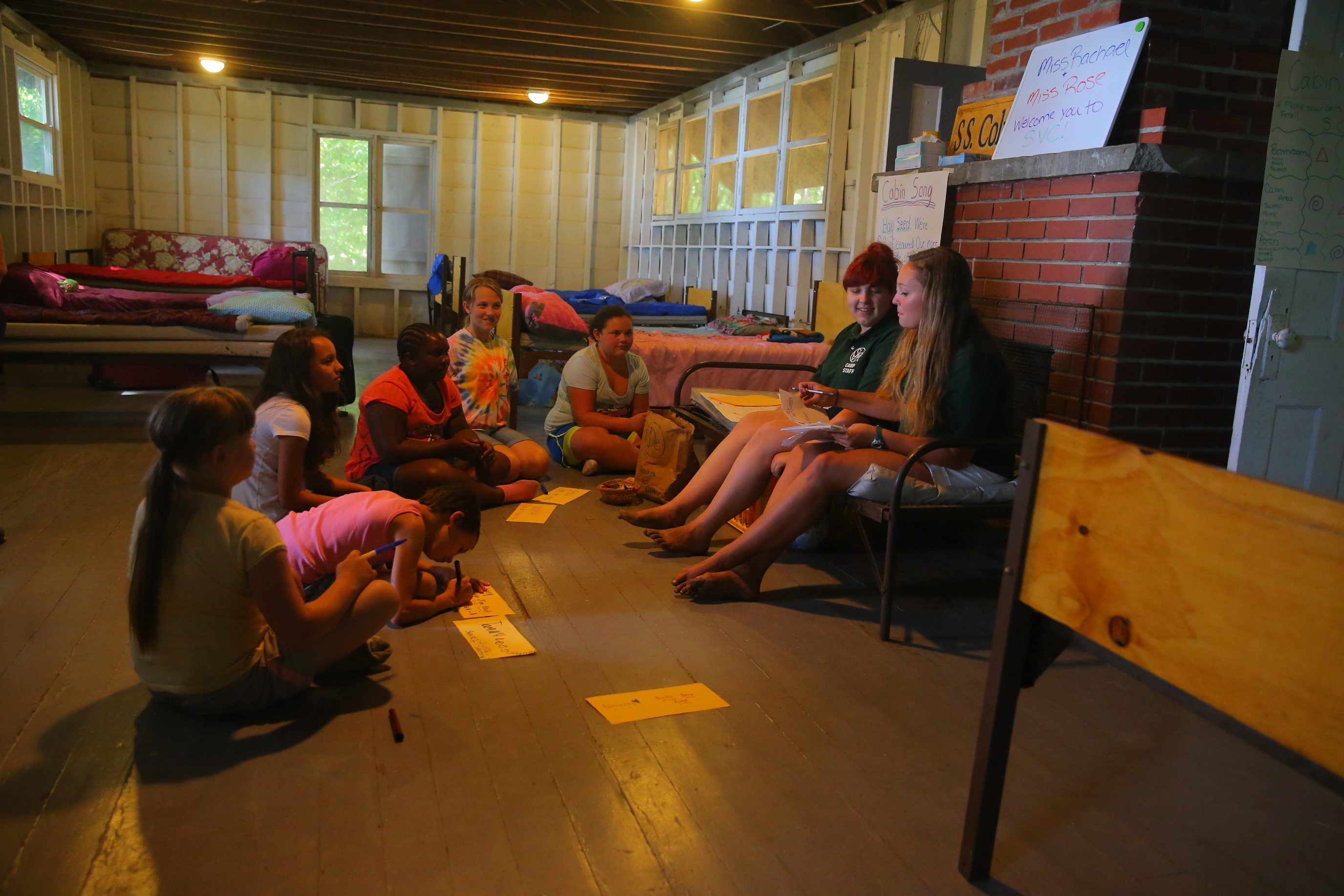 Children learn their cabin song and break the ice by talking, singing and picking a camp name at  St. Vincent de Paul summer camp in Angola. (John Hickey/Buffalo News)