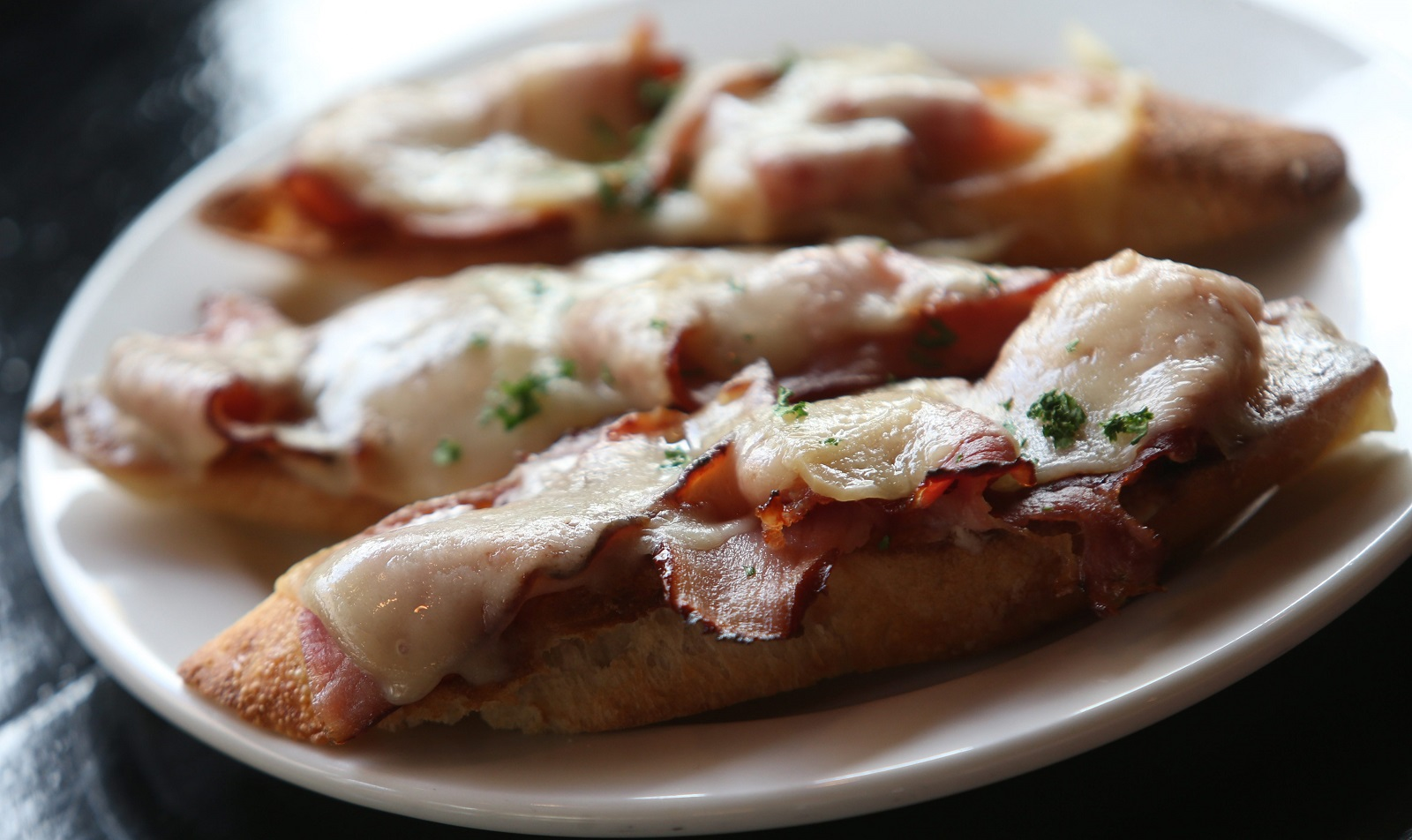 Raclettes' croque monsieur comes with toasted ham and gruyere. (Sharon Cantillon/Buffalo News)