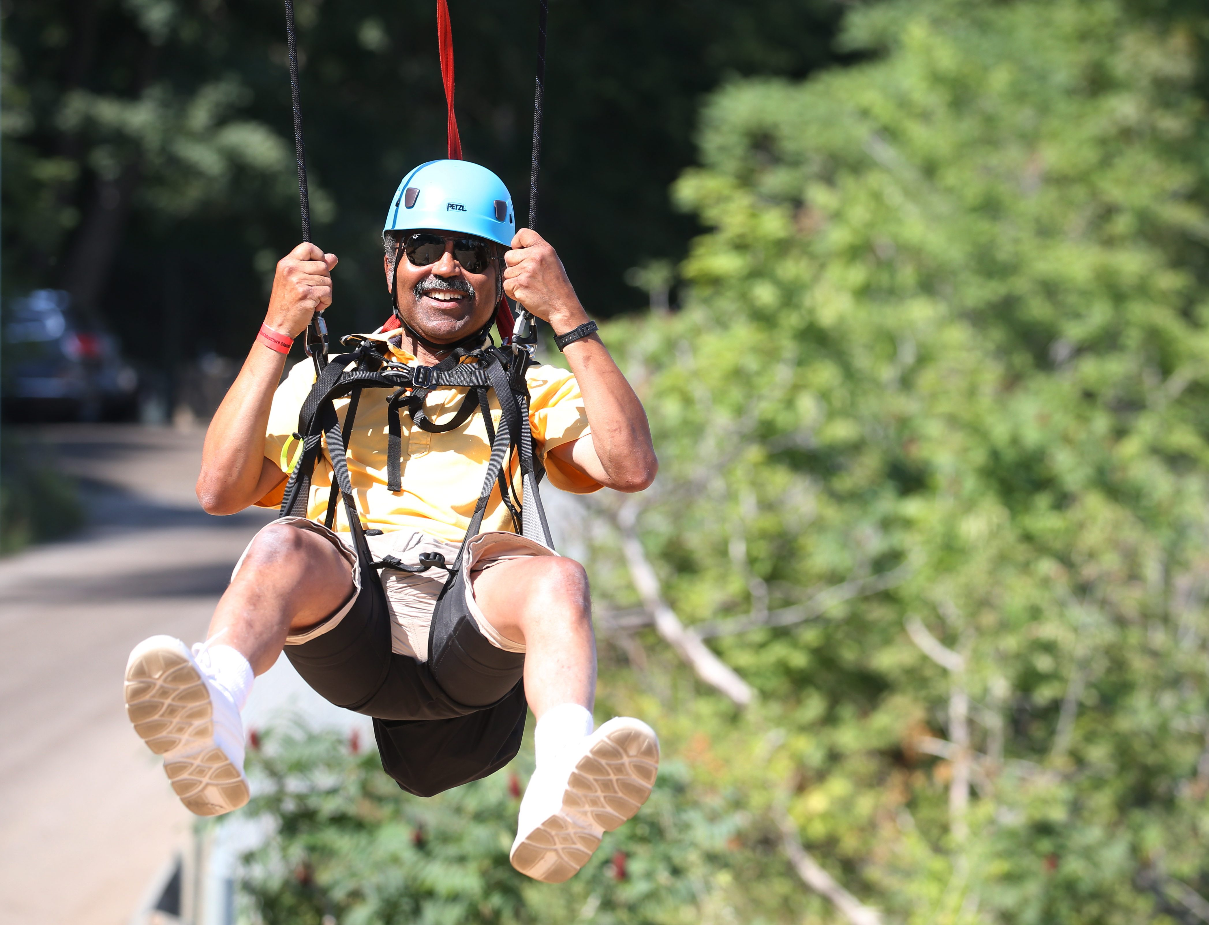 WildPlay's MistRider Zipline in Niagara Falls, Ont., descends 2,200 feet into the gorge. Buffalo News Urban Affairs Editor Rod Watson gets his turn on the zip line and comes in for the landing. (Sharon Cantillon/Buffalo News)