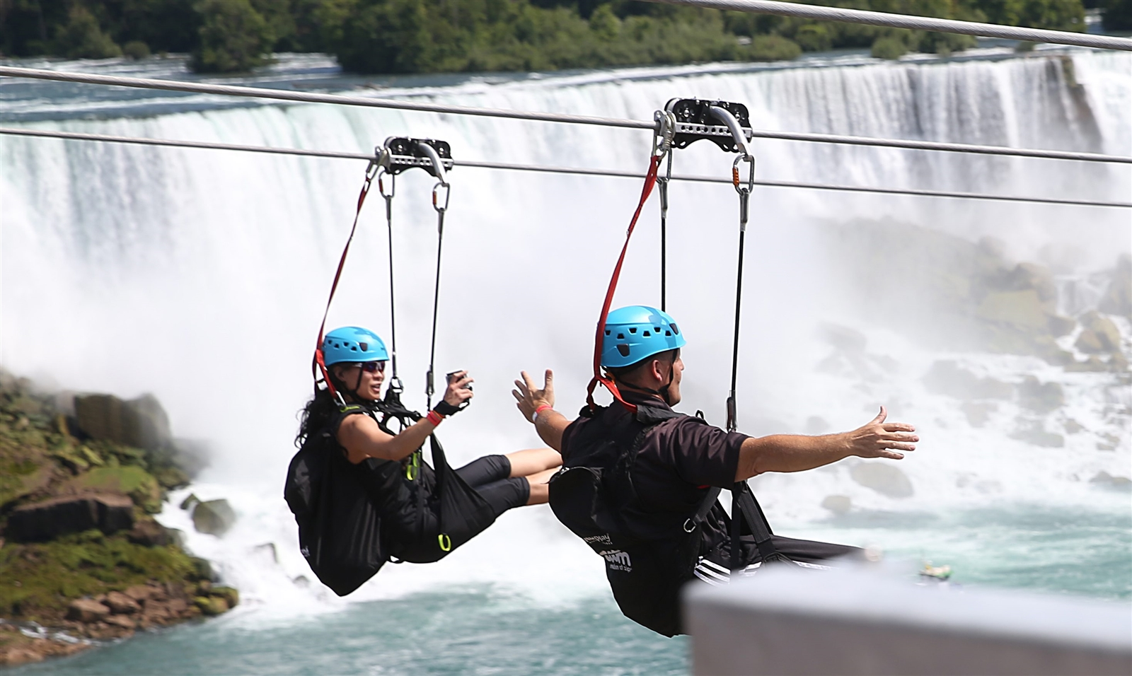 Riders on the new 'MistRider' zip line, which officially opened today on the Canadian side of Niagara Falls. (Sharon Cantillon/The Buffalo News)