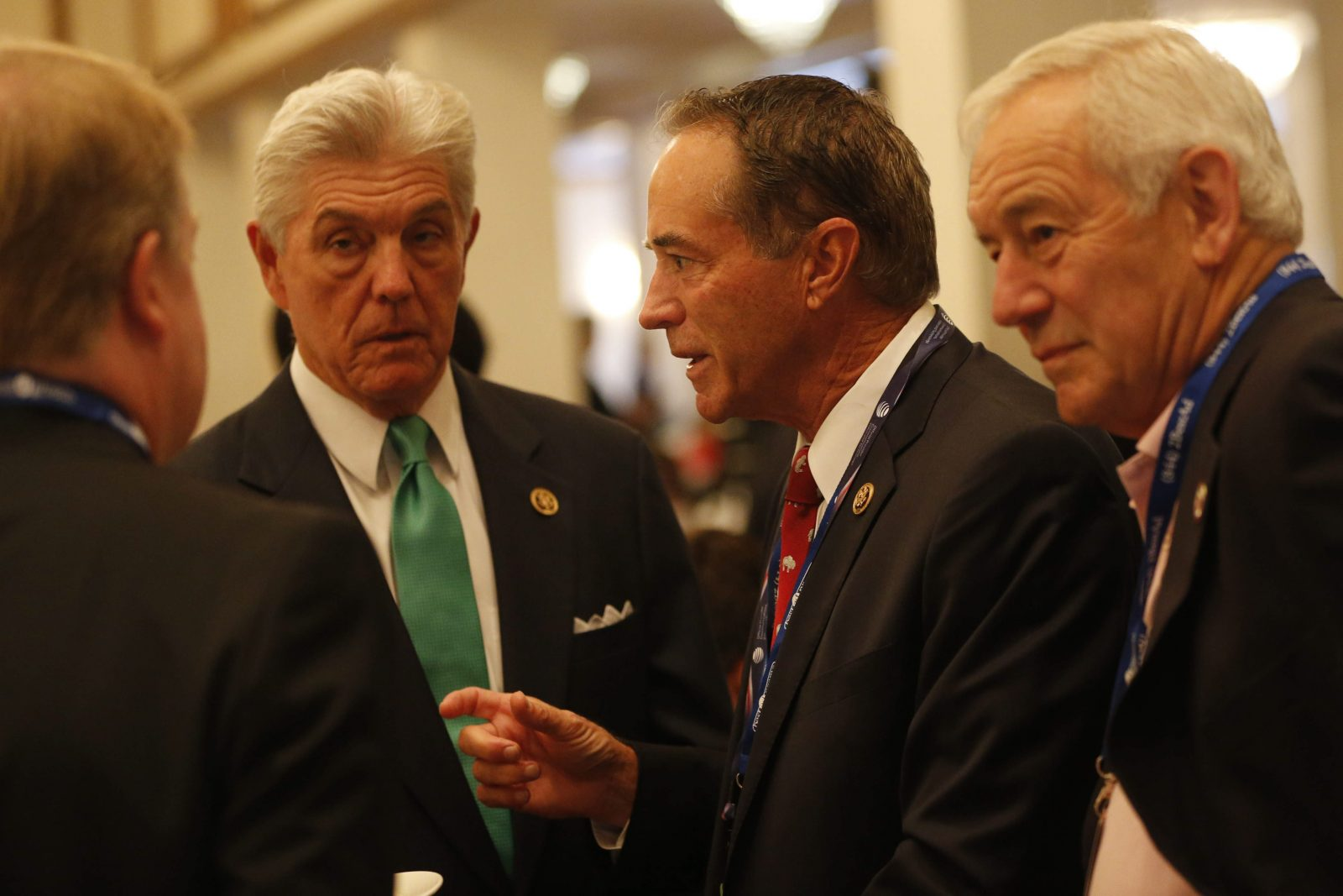 Rep. Chris Collins, center, mingles during the New York Delegation Breakfast at the Renaissance Hotel in Cleveland, Ohio, Tuesday, July 19, 2016. (Photo by Derek Gee)