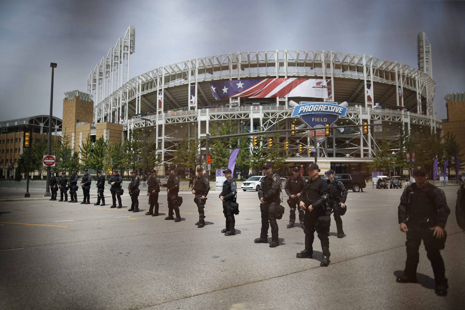 Police officers stand in formation outside Progressive Field in Cleveland behind a metal barrier July 21. (Derek Gee/Buffalo News)