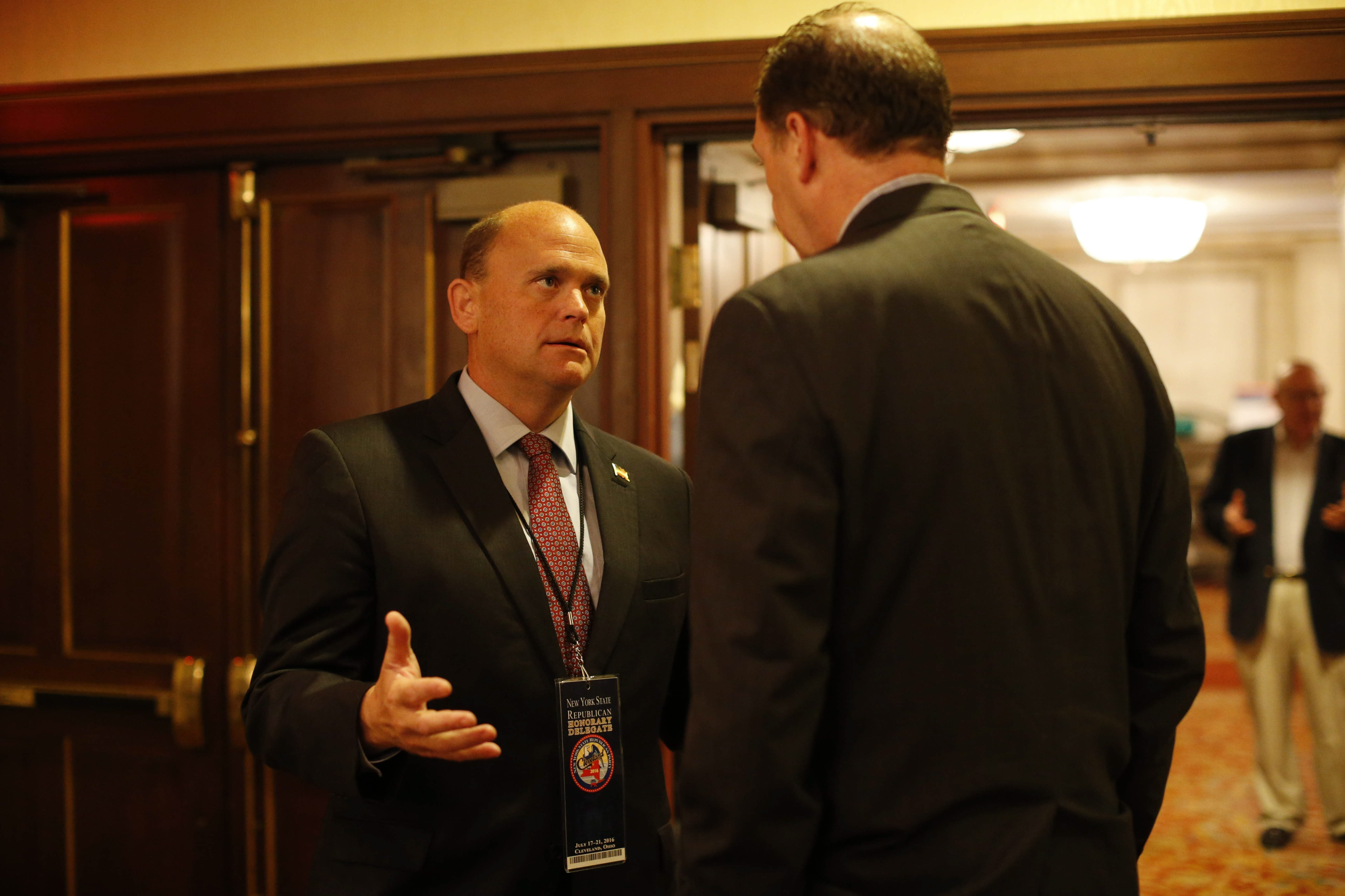 Rep. Tom Reed of Corning mingles prior to giving a speech during the New York delegation breakfast at the Renaissance Hotel, on July 20.  (Derek Gee/Buffalo News)