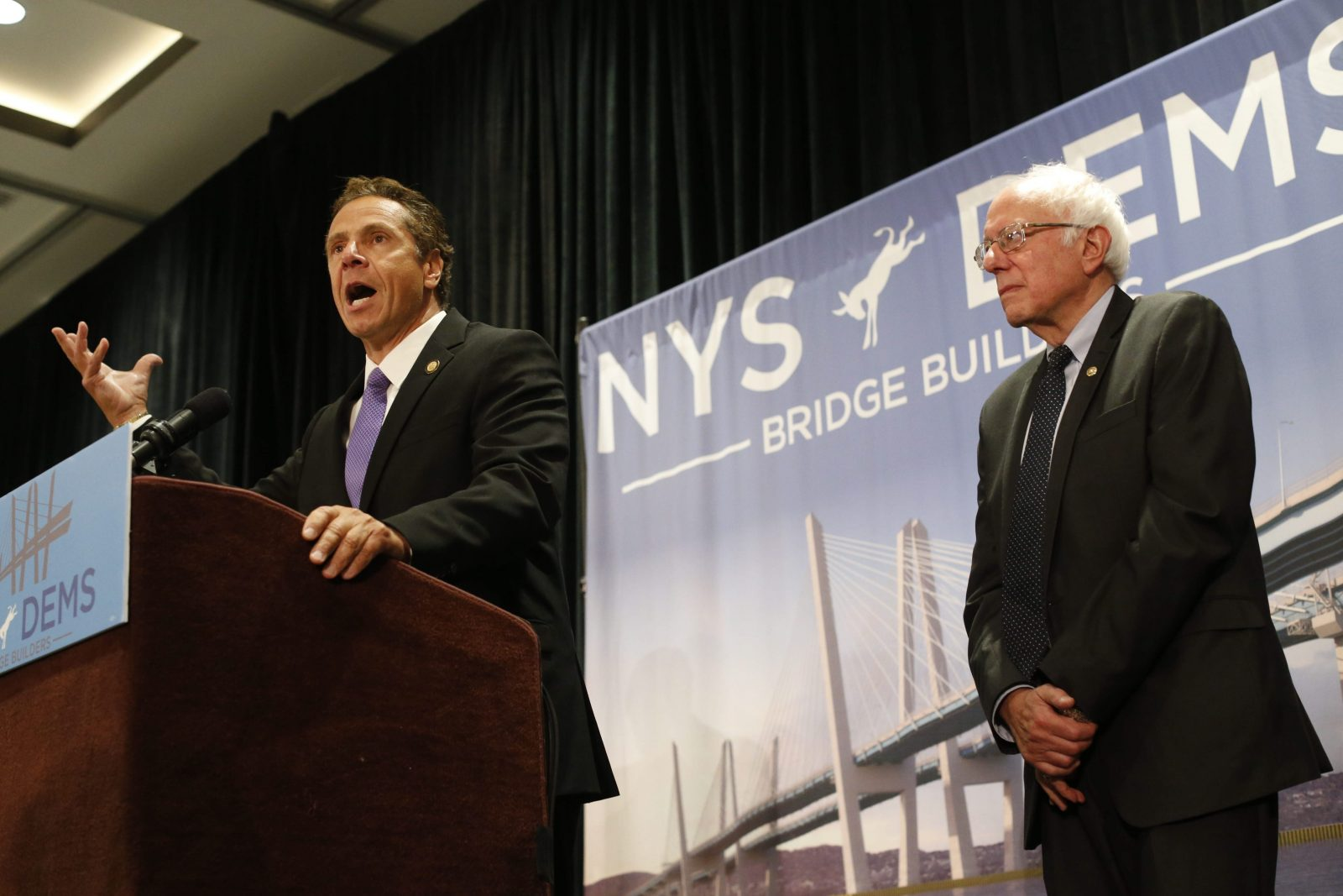 N.Y. Gov. Andrew Cuomo, left, introduces Sen. Bernie Sanders during the New York delegation breakfast. (Derek Gee/Buffalo News)