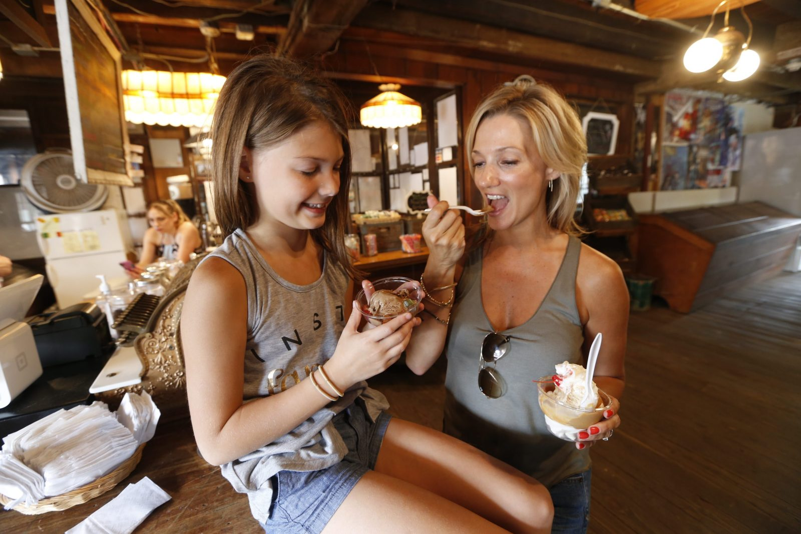 Erika Rosen of Gettzville and her daughter Abigail, 9, enjoy some hand-crafted ice cream at Sweet Jenny's. (Robert Kirkham/Buffalo News)