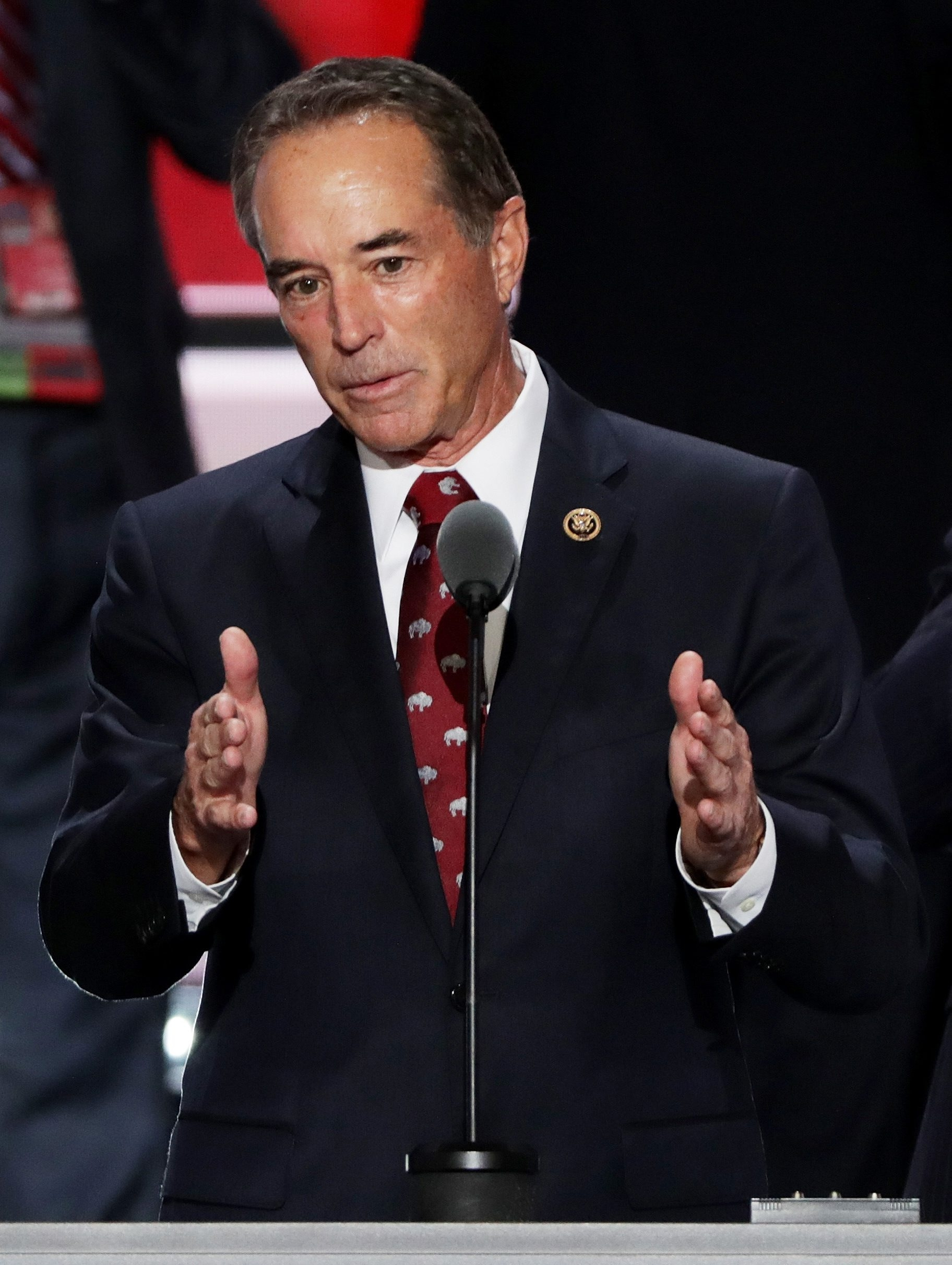 Rep. Chris Collins, R-Clarence, tests sound on convention podium before giving one of the nominating speeches for Donald Trump.