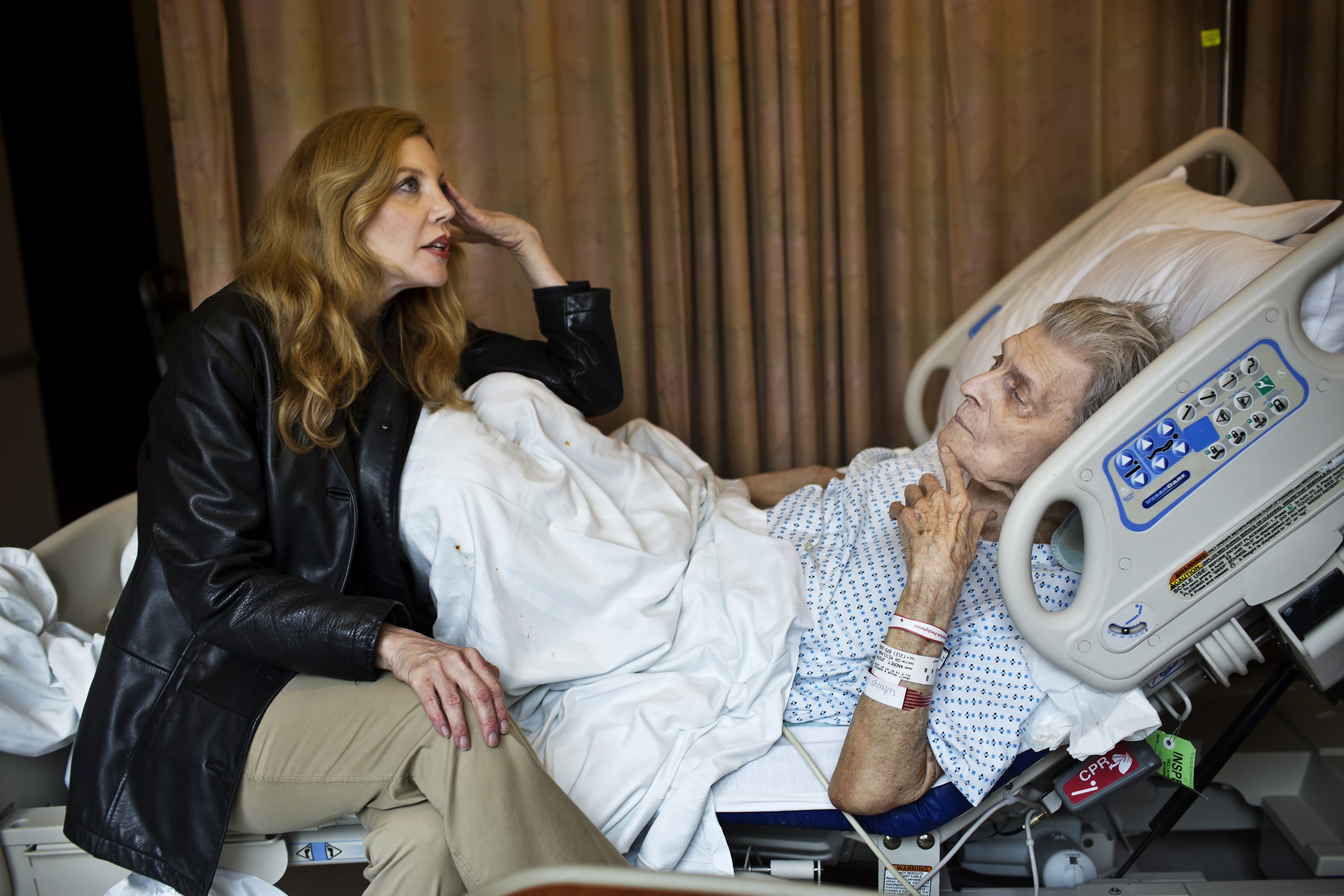 A woman visits with her father in New York Presbyterian Hospital, prior to his being moved to a nursing home in 2013. End-of-life care remains an issue of concern for many New Yorkers.