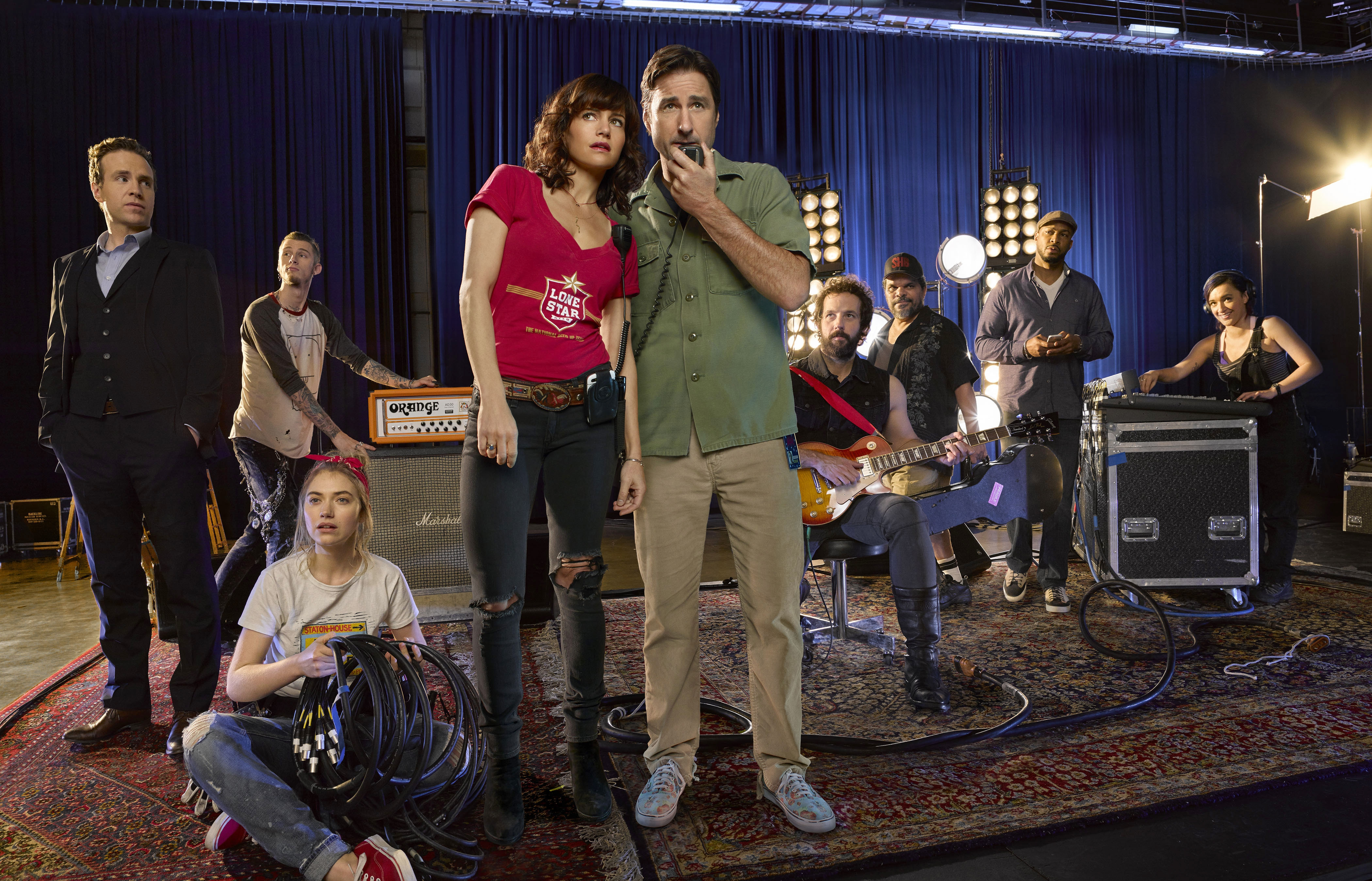 """From left, Rafe Spall, Colson Baker, Imogen Poots, Carla Gugino, Luke Wilson, Peter Cambor, Luis Guzmán, Finesse Mitchell and Keisha Castle-Hughes in """"Roadies."""""""