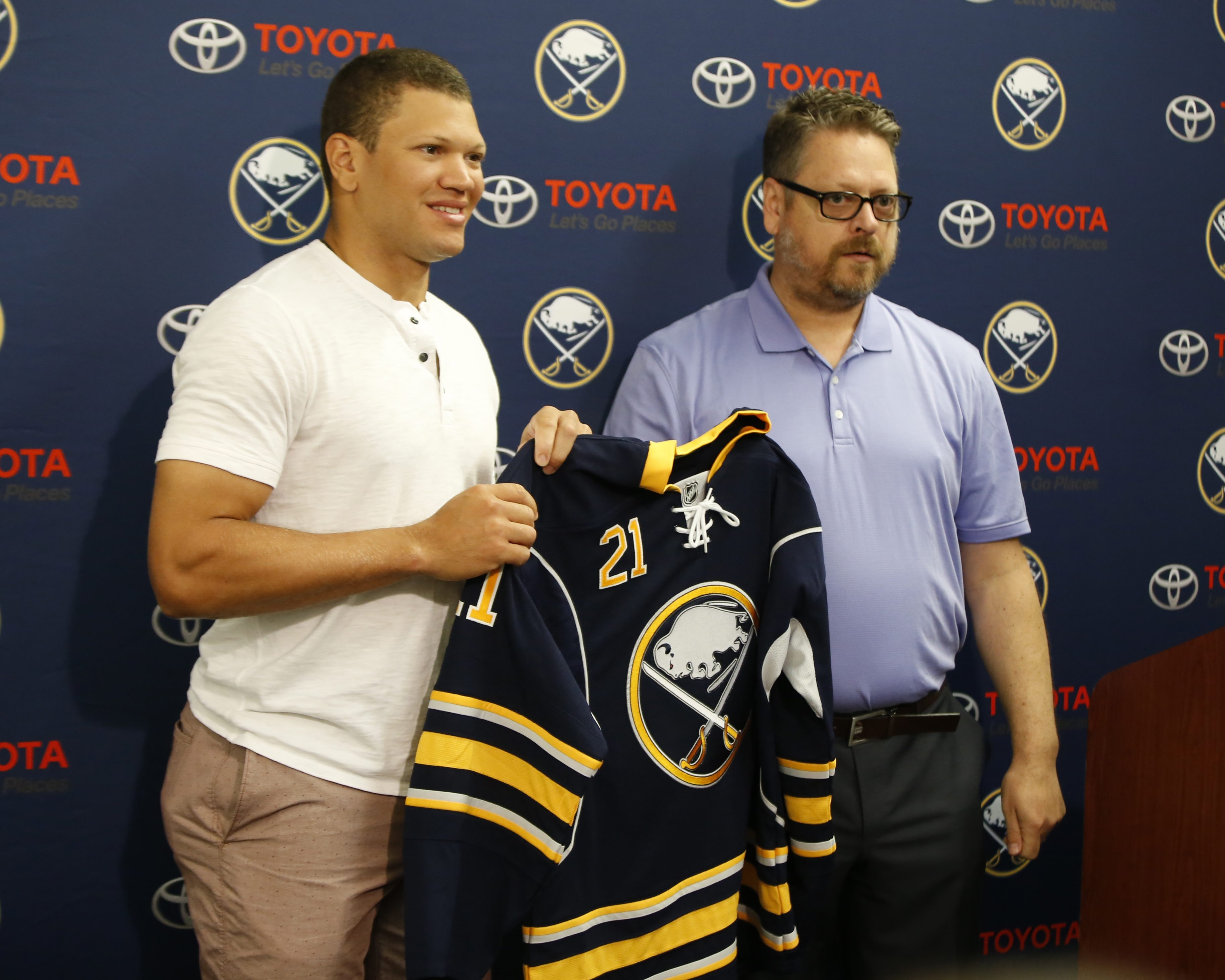 Buffalo Sabres General Manager Tim Murray, right, and right winger Kyle Okposo meet with the media at First Niagara Center on Thursday.