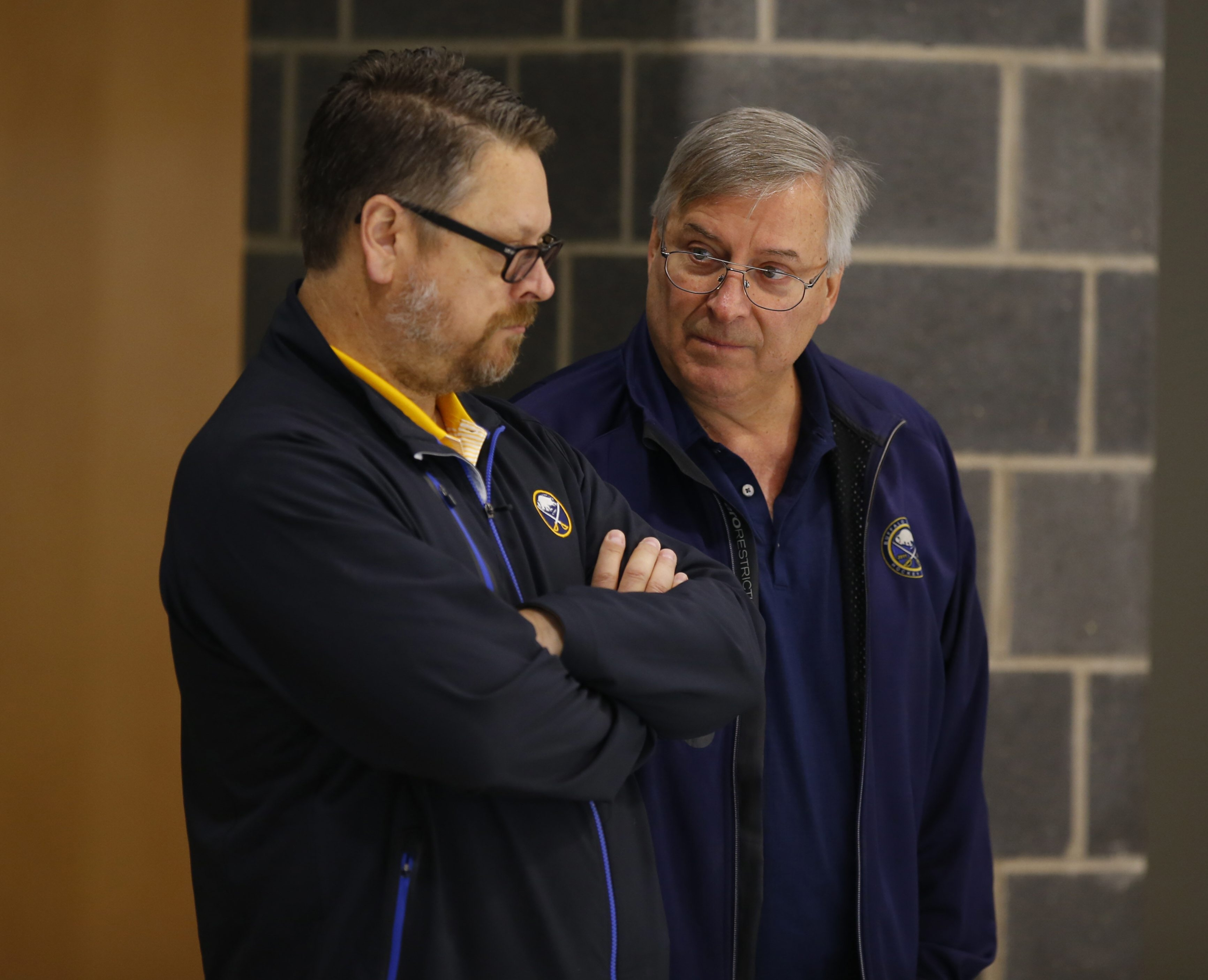 Buffalo Sabres owner Terry Pegula, right, huddles with General Manager Tim Murray on Tuesday during the three-on-three tournament at development camp in HarborCenter.