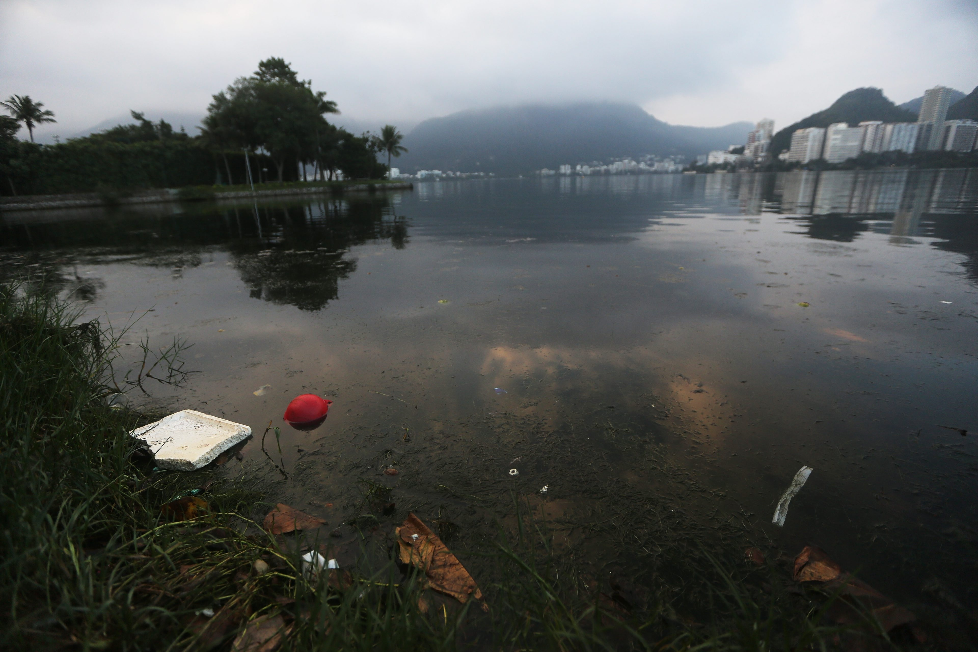 Garbage floats in the polluted Rodrigo de Freitas Lagoon, venue for the rowing events at the Rio 2016 Olympic Games, on July 1.