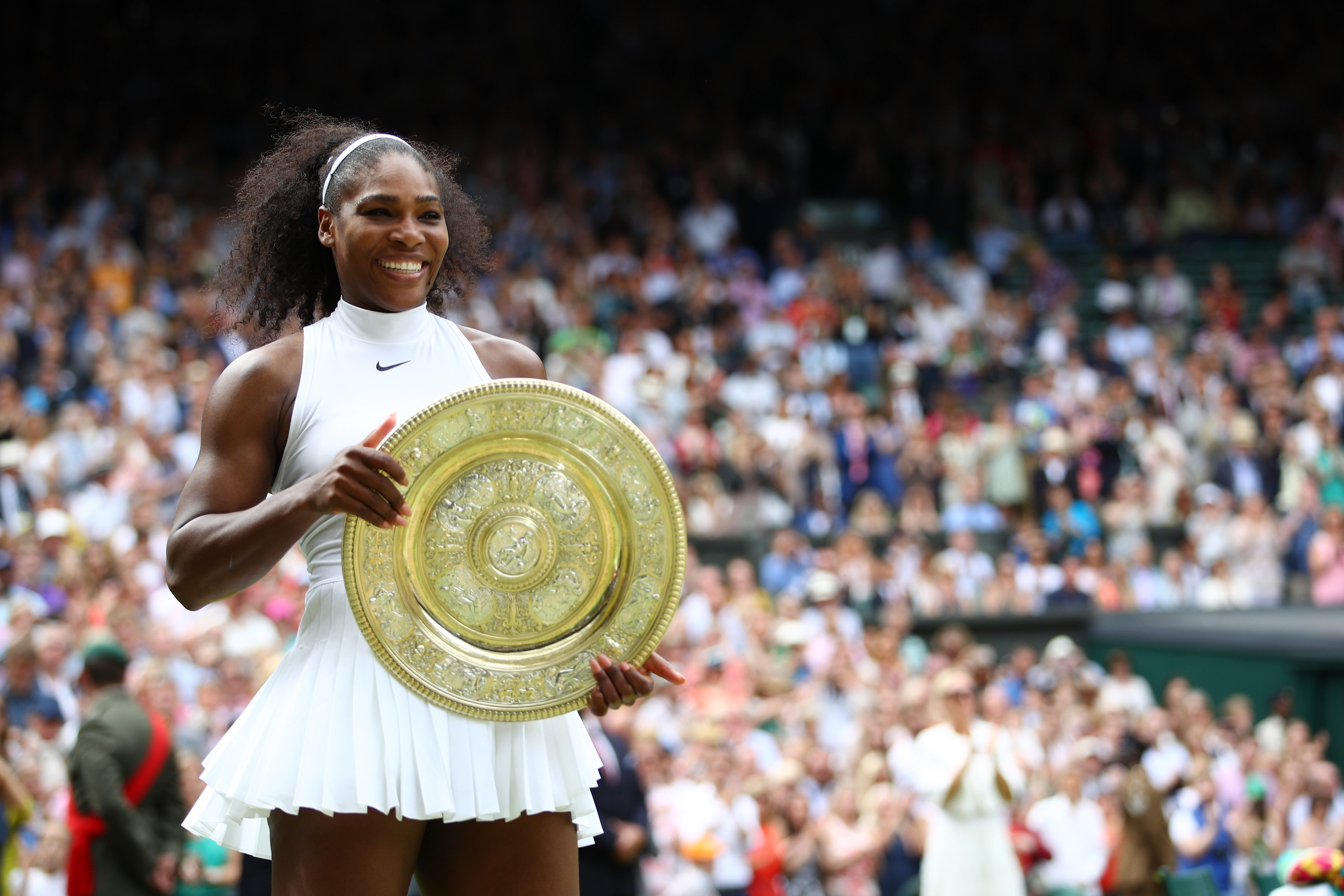 Serena Williams poses following her victory at Wimbledon.