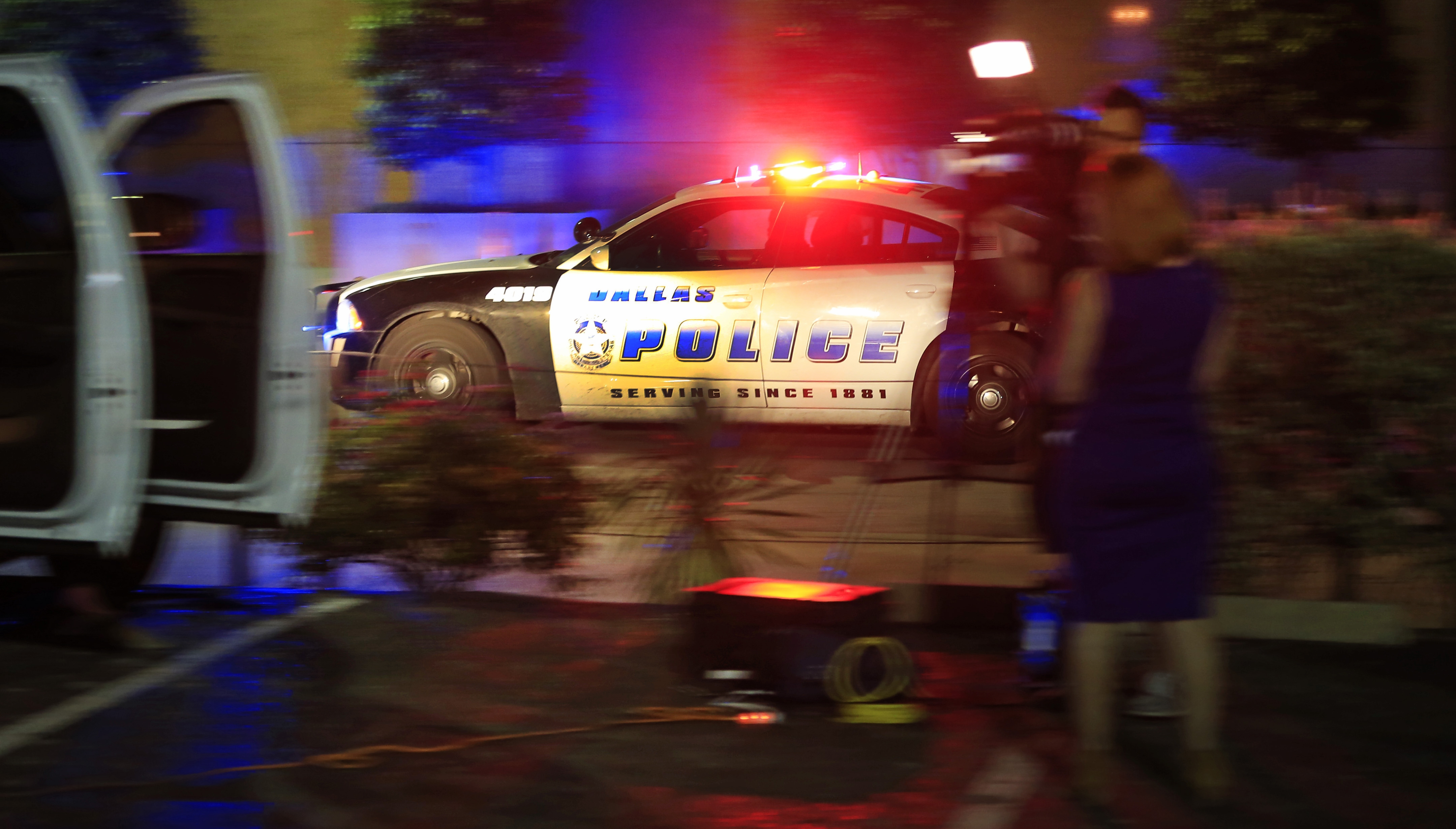 A Dallas police officer drives near the scene where eleven Dallas police officers were shot and five have now died on July 7, 2016 in Dallas, Texas. (Getty Images)