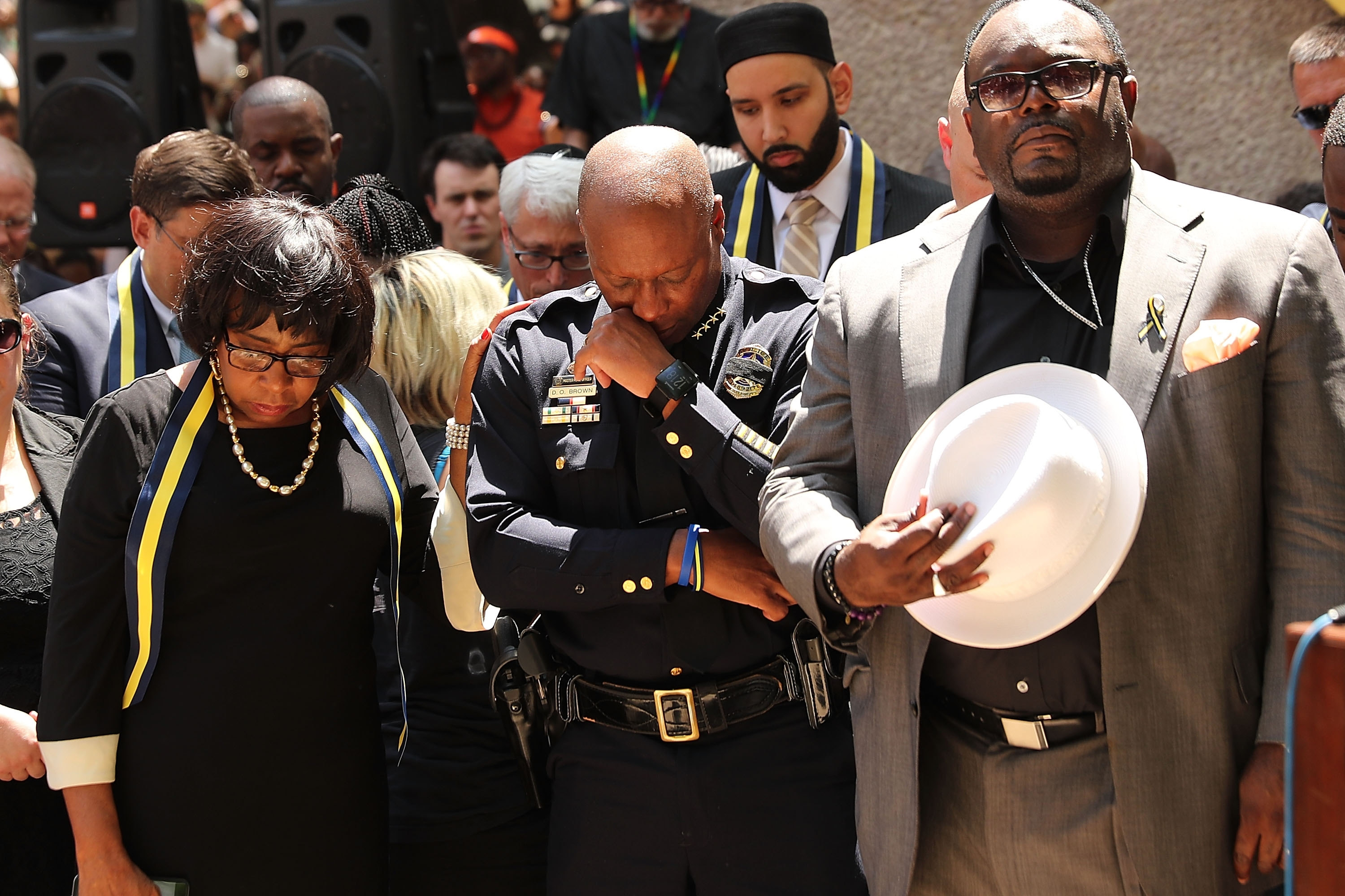 Dallas Police Chief David Brown bows his head during a prayer vigil for the five slain police officers.