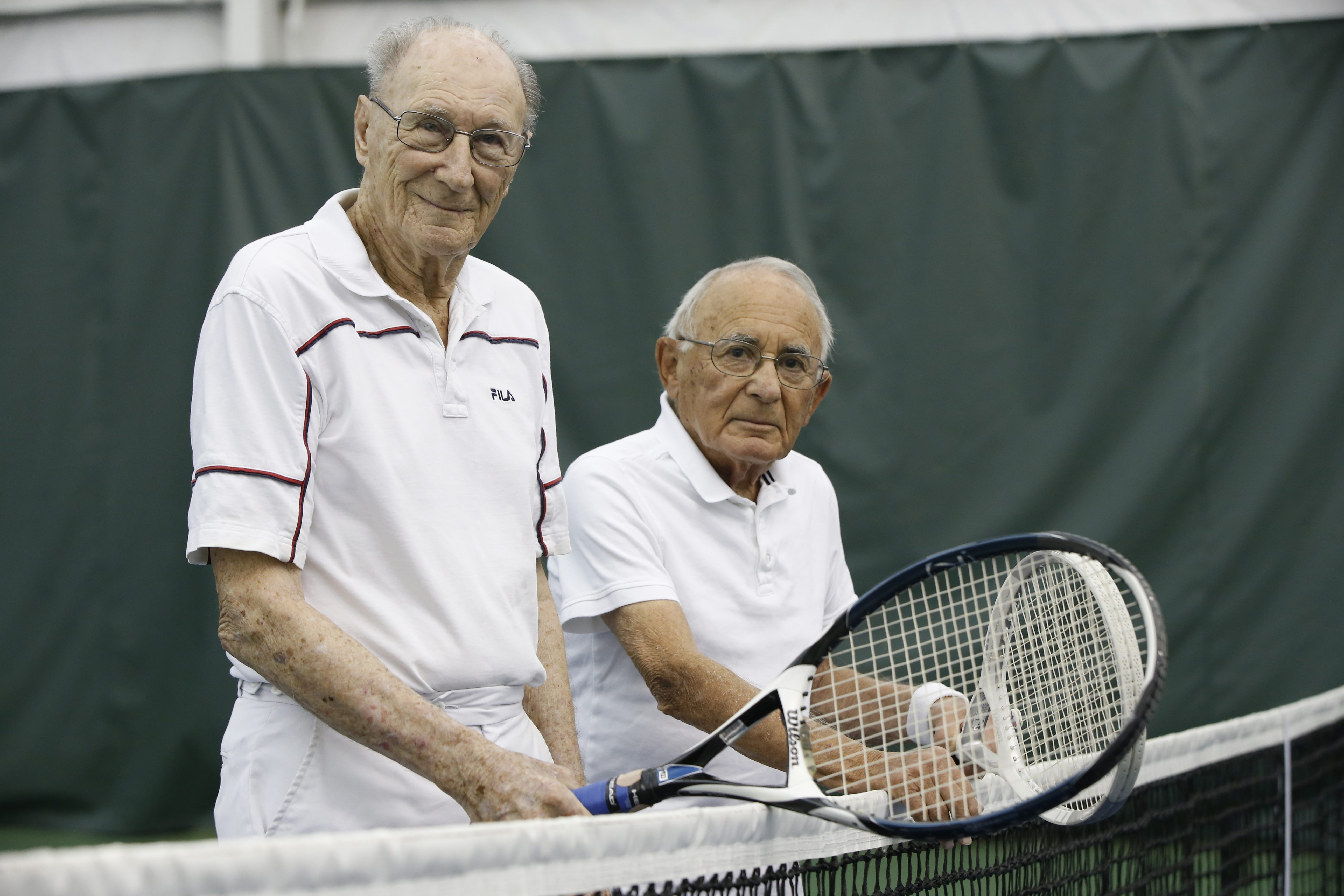 Mort Rothstein, left, 94, and Joe Masling, 92, hit the court together weekly at the Village Glen Tennis Club. Both give a good account for themselves during matches.