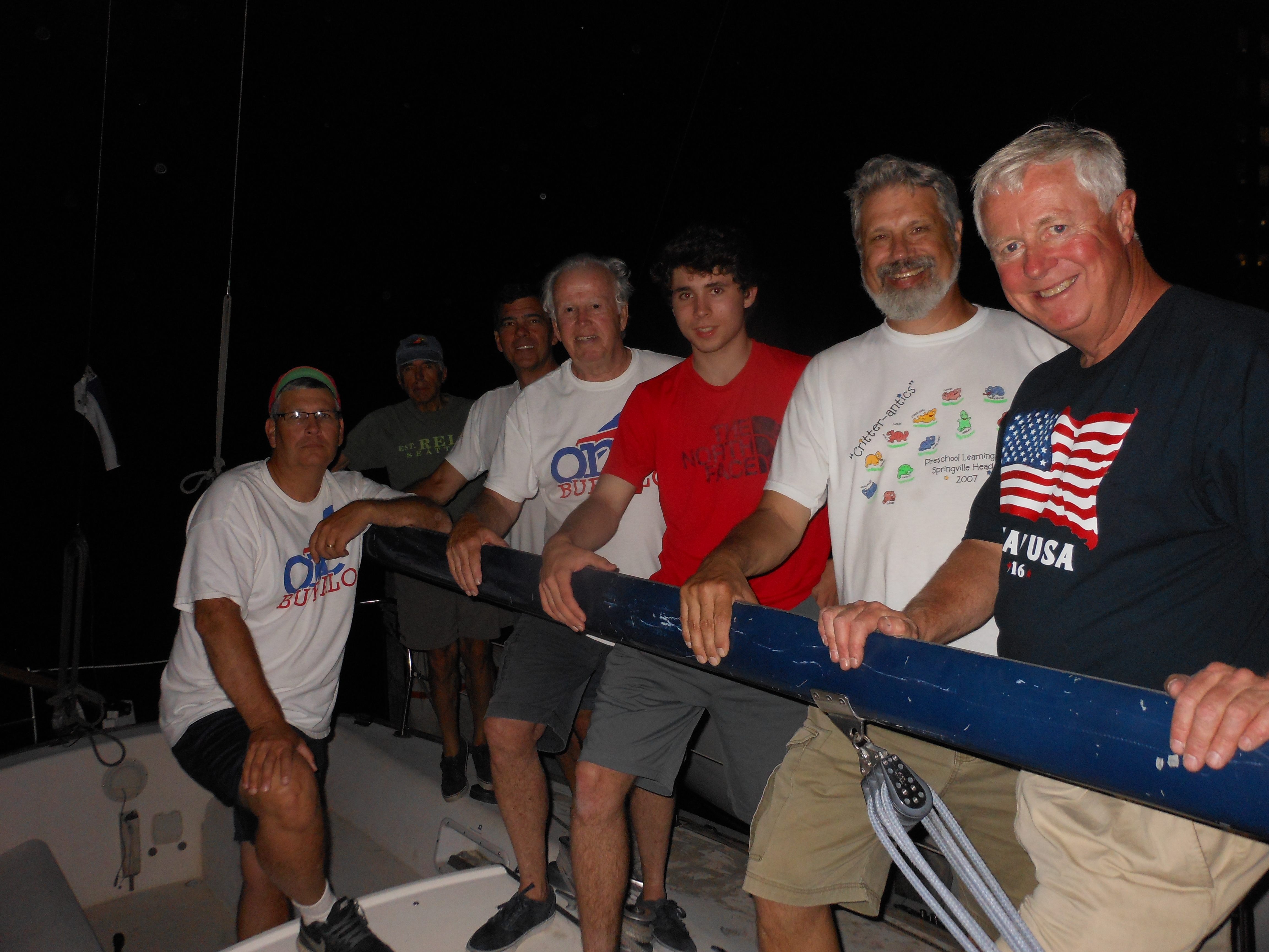 Capt. Jack Mathias, at right, with his sailing crew after a Wednesday-night competition out of RCR Yachts at Skyway Marina. Holding the boom, from the left, are Greg Hylkema, Ken Kahn, Tom LeBuhn, Tim O'Brien, Patrick Hylkema and Bill Lewis.