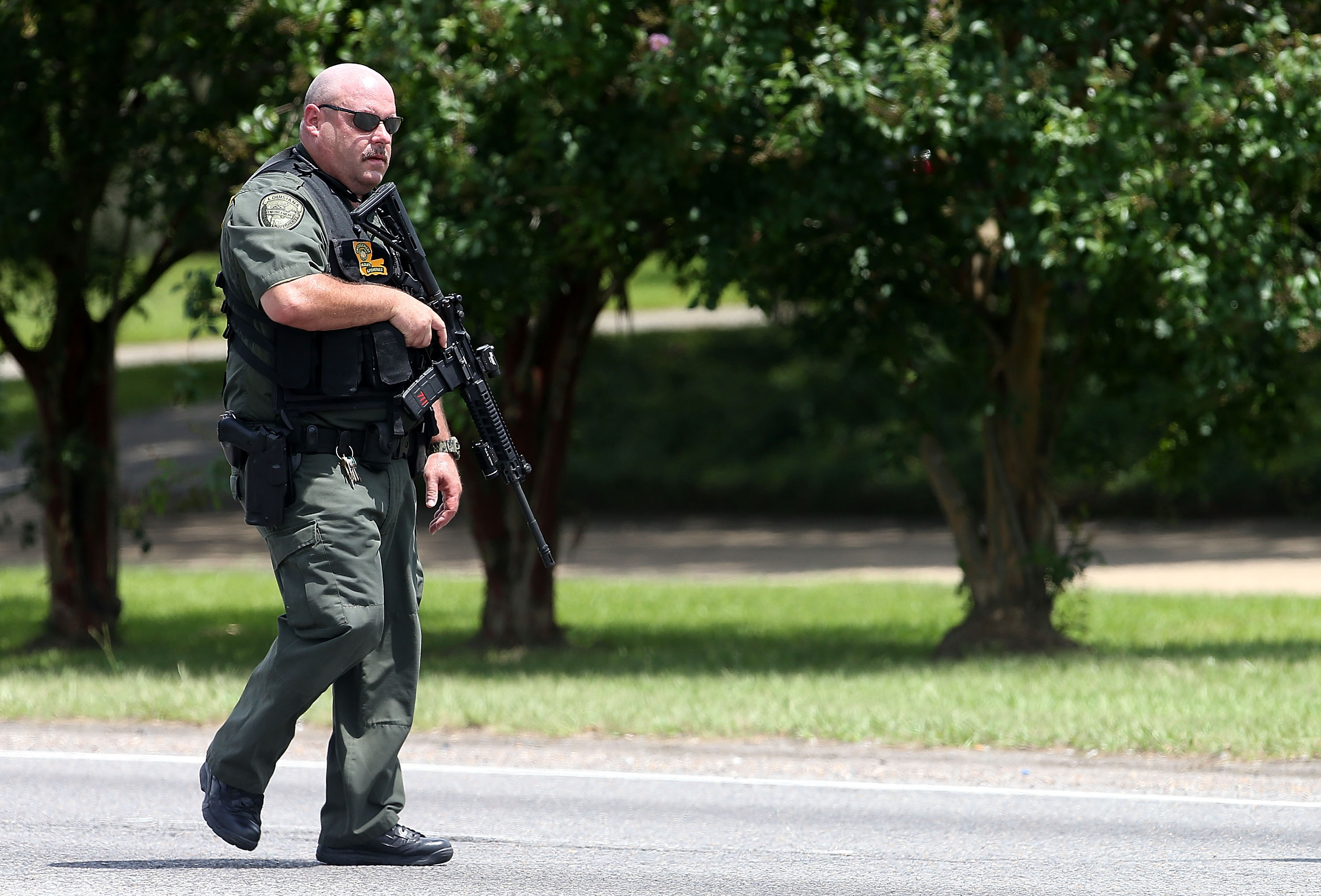 Baton Rouge Police officers patrol Airline Highway after three police officers were killed there early the morning of July 17 in Baton Rouge, La. (Sean Gardner/Getty Images)