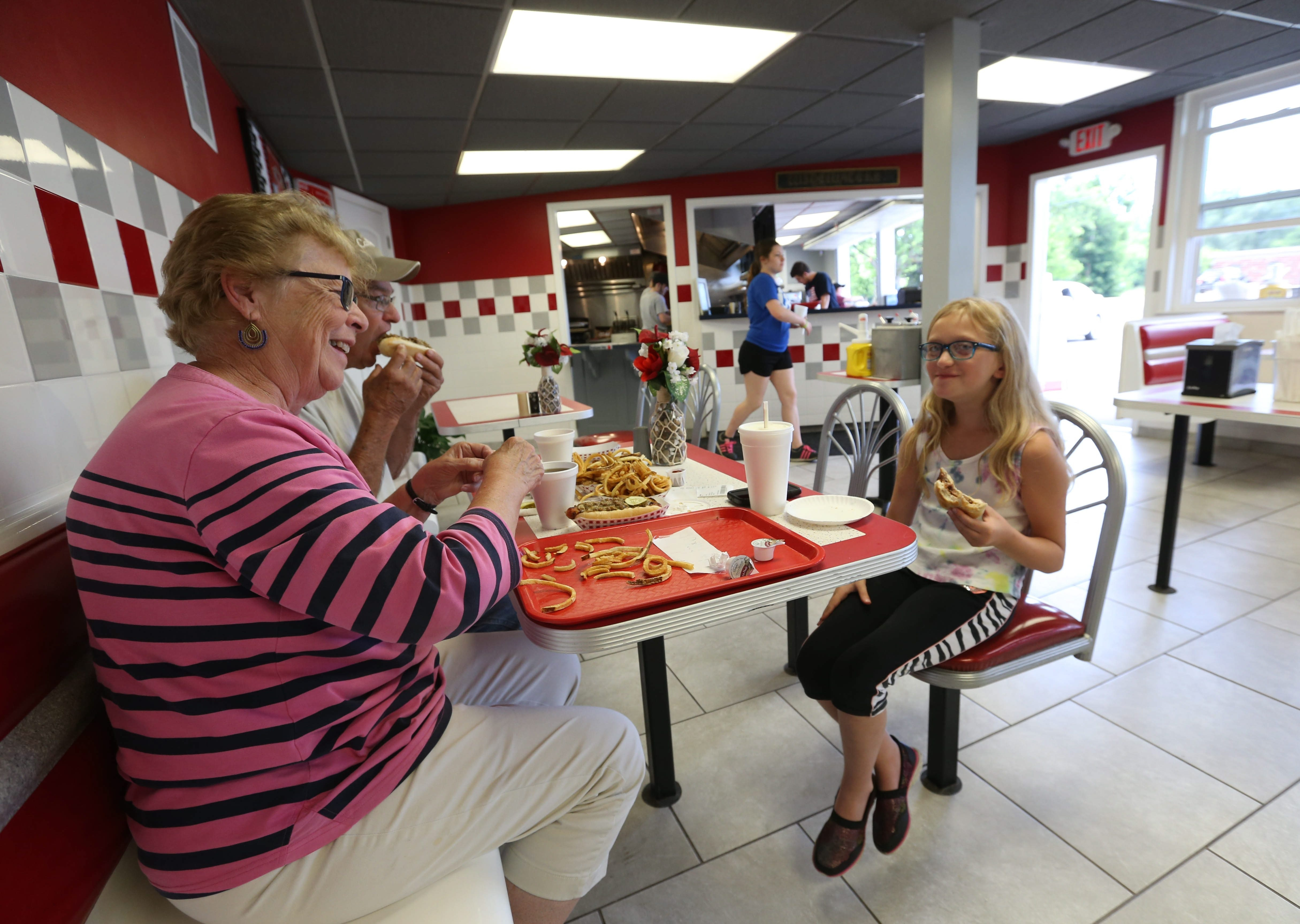 Judy and Marv Farnham of Lockport have dinner with their granddaughter Karina Farnham, 9, of Ransomville. Below, the Coney Island hot dog. See a photo gallery at buffalonews.com.