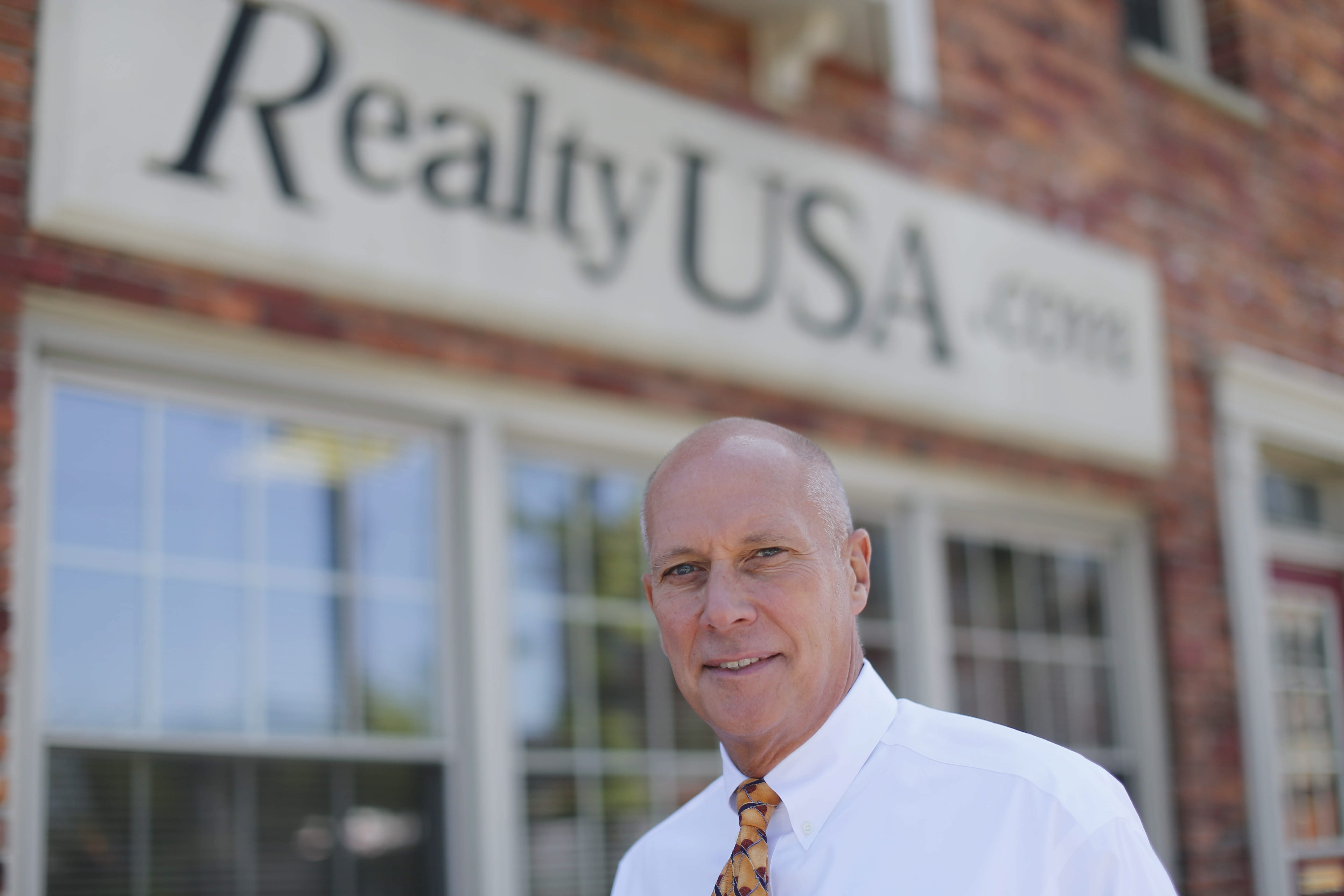 Realty USA President and CEO Merle L. Whitehead sold his company to Howard Hanna Real Estate Services of Pittsburgh.   (Derek Gee/Buffalo News)