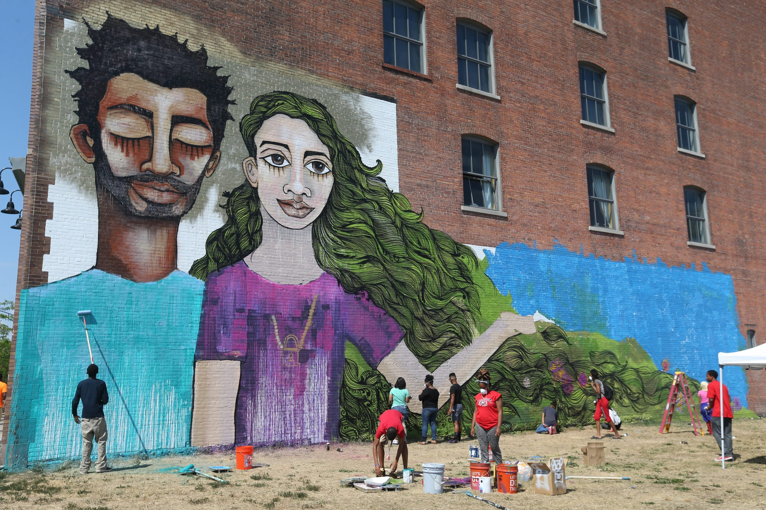 Thanks to a partnership between the Buffalo Center for Arts and Technology and the Albright-Knox Art Gallery, a  giant mural is now visible on the center's west wall at 1221 Main St. Students in the art program are working with well-known Brooklyn muralist Alice Mizrachi.